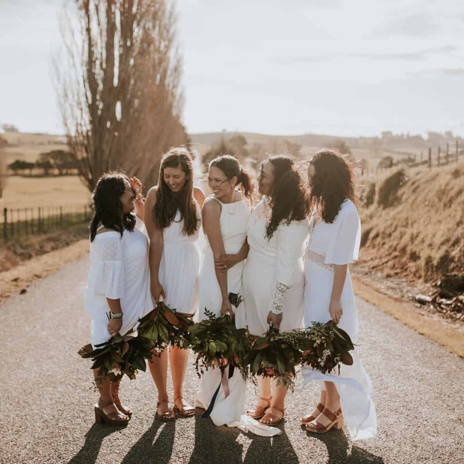 bridesmaids in mixed white dresses