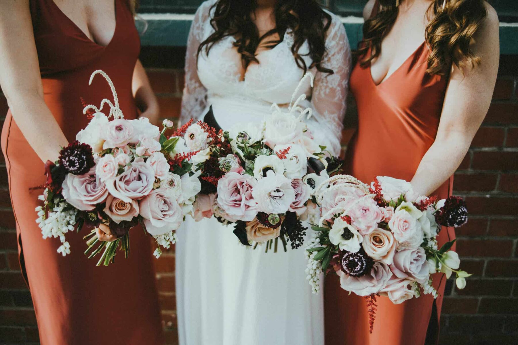 terracotta-toned bridesmaid dresses by Natalie Rolt