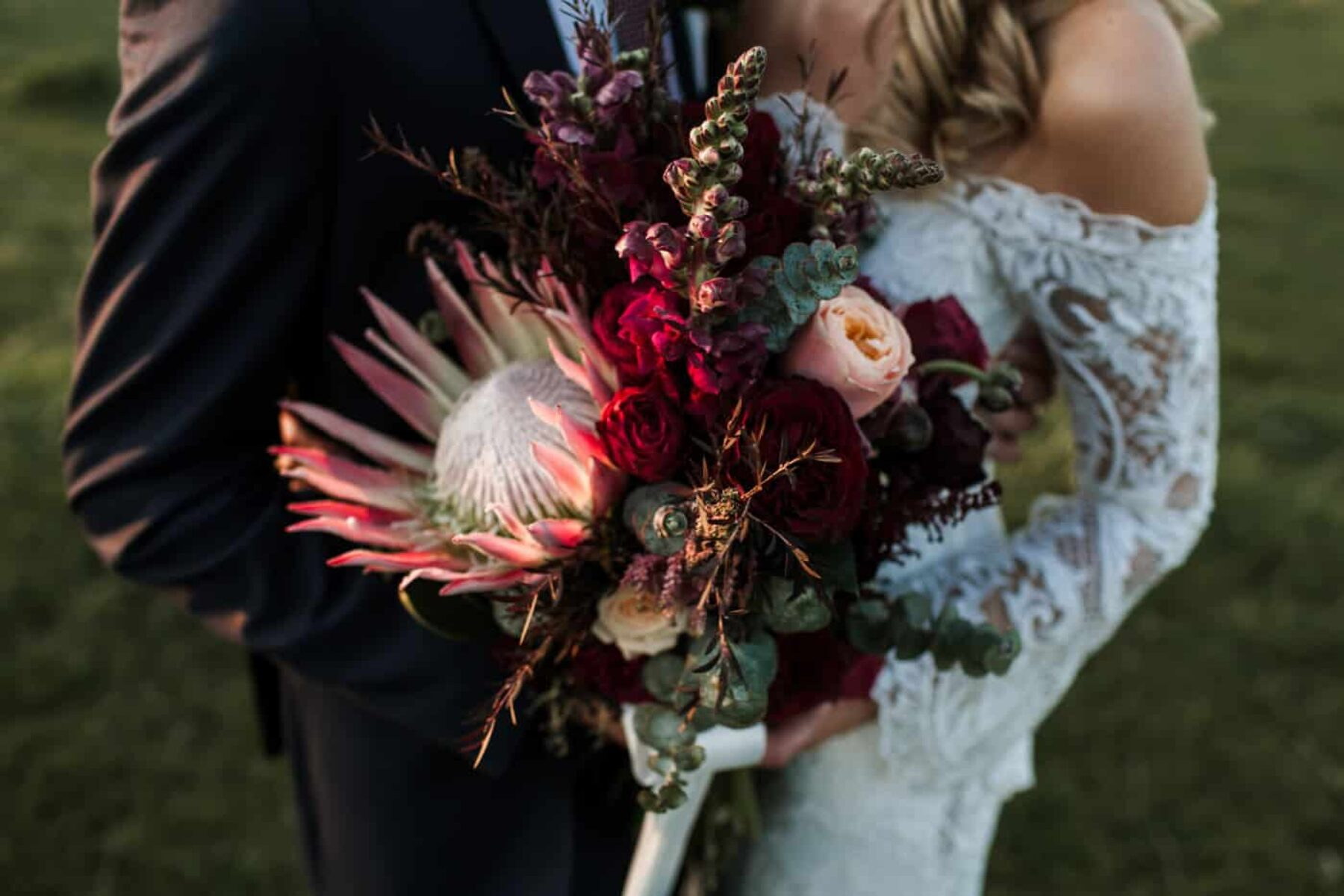 blush and burgundy bouquet with giant king protea