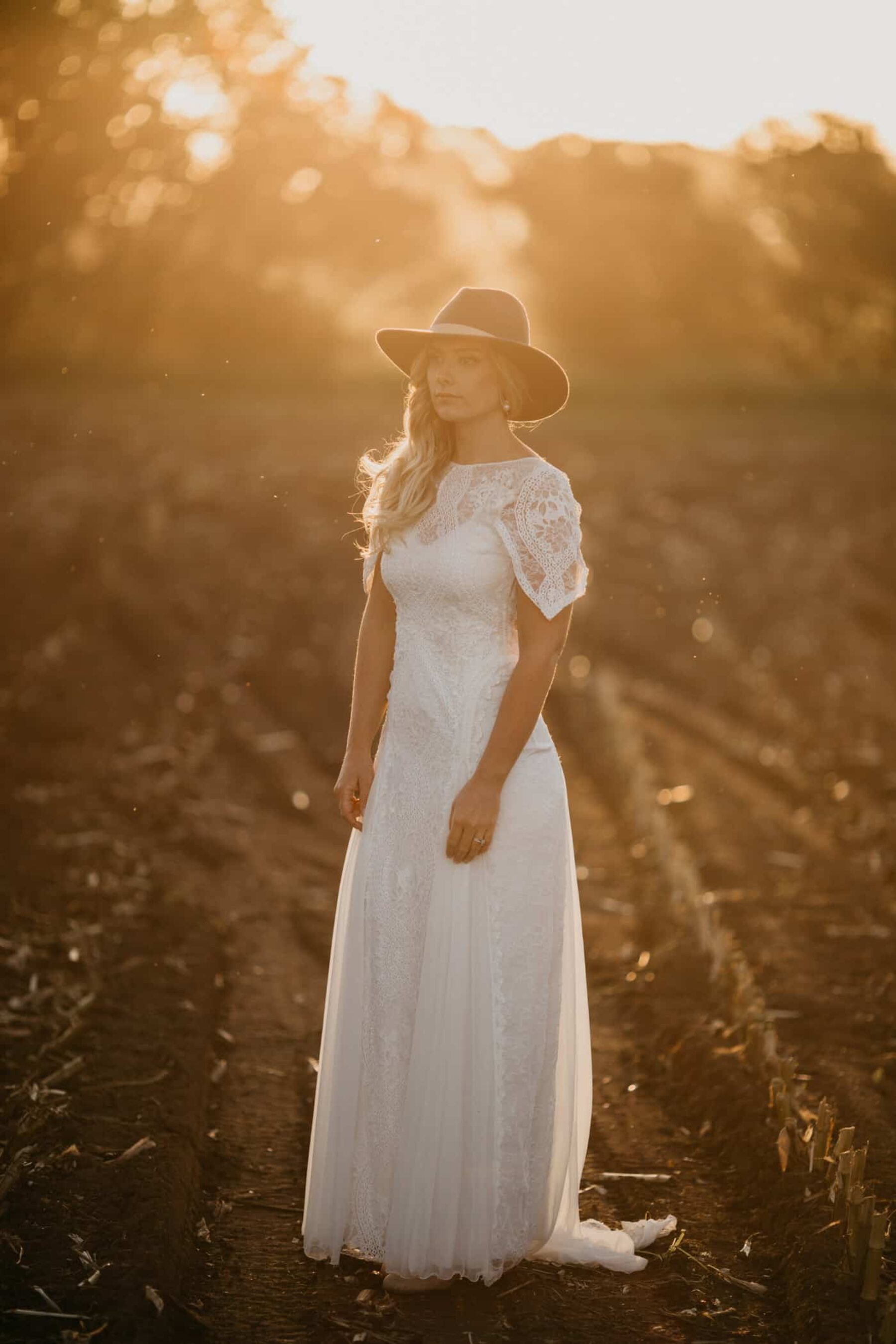 boho bride in Grace Loves Lace gown and fedora hat