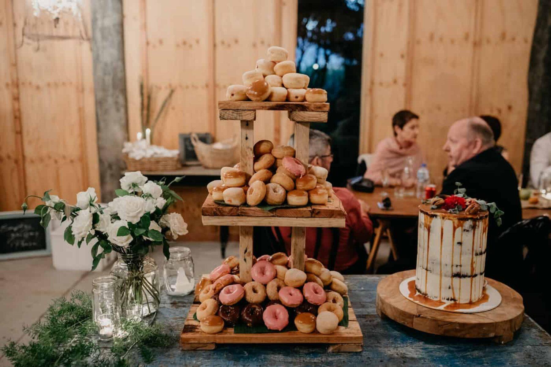 donut tower and caramel drip wedding cake