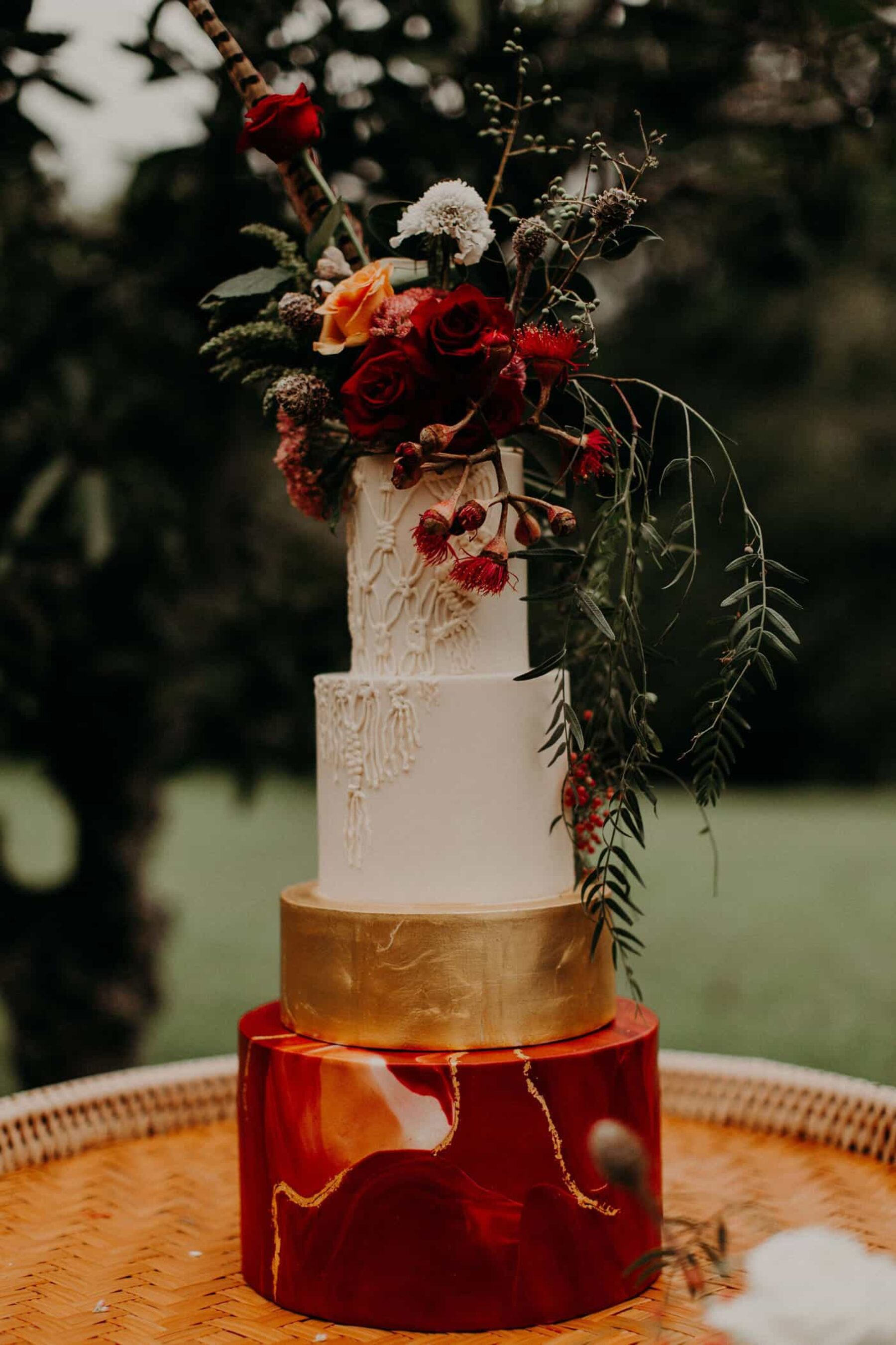 four tier cake with marble and gold detail