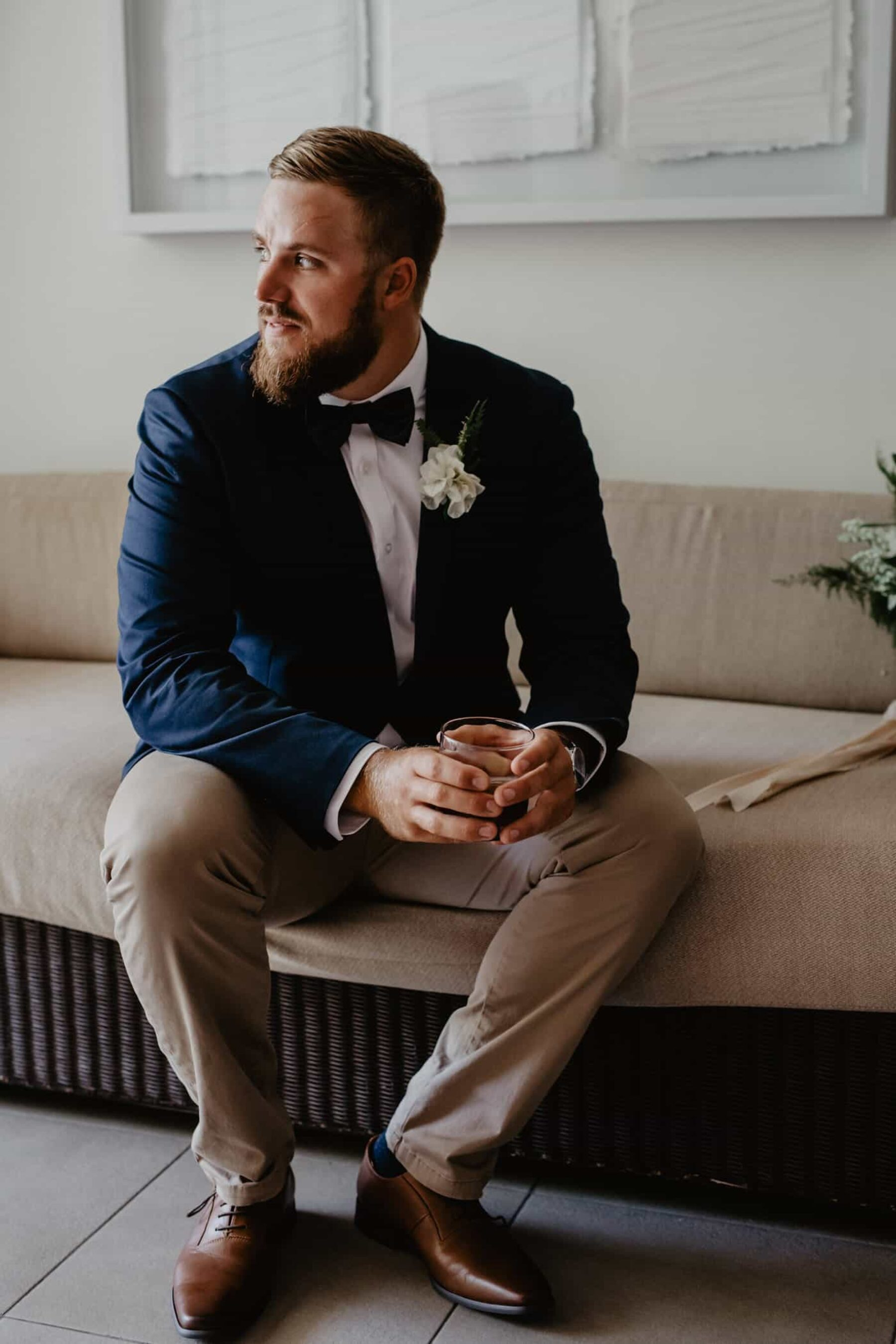 groom in navy blazer and tan chinos