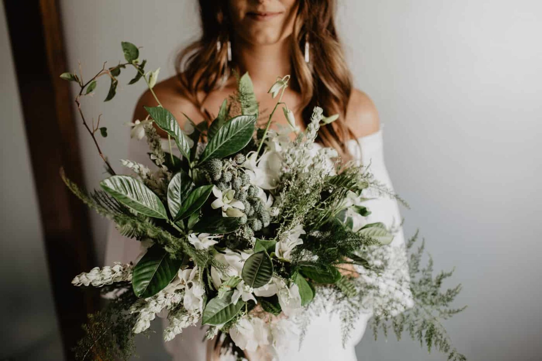 green and white bridal bouquet with silk ribbons