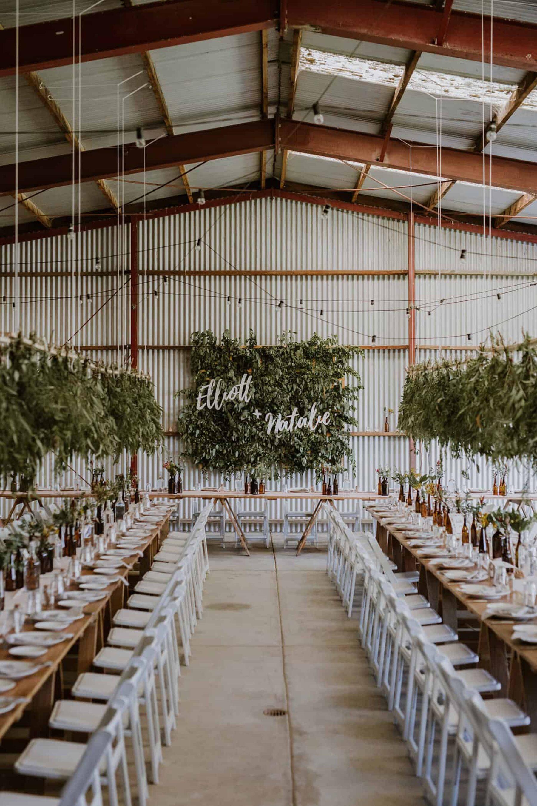 DIY barn wedding with foliage wall