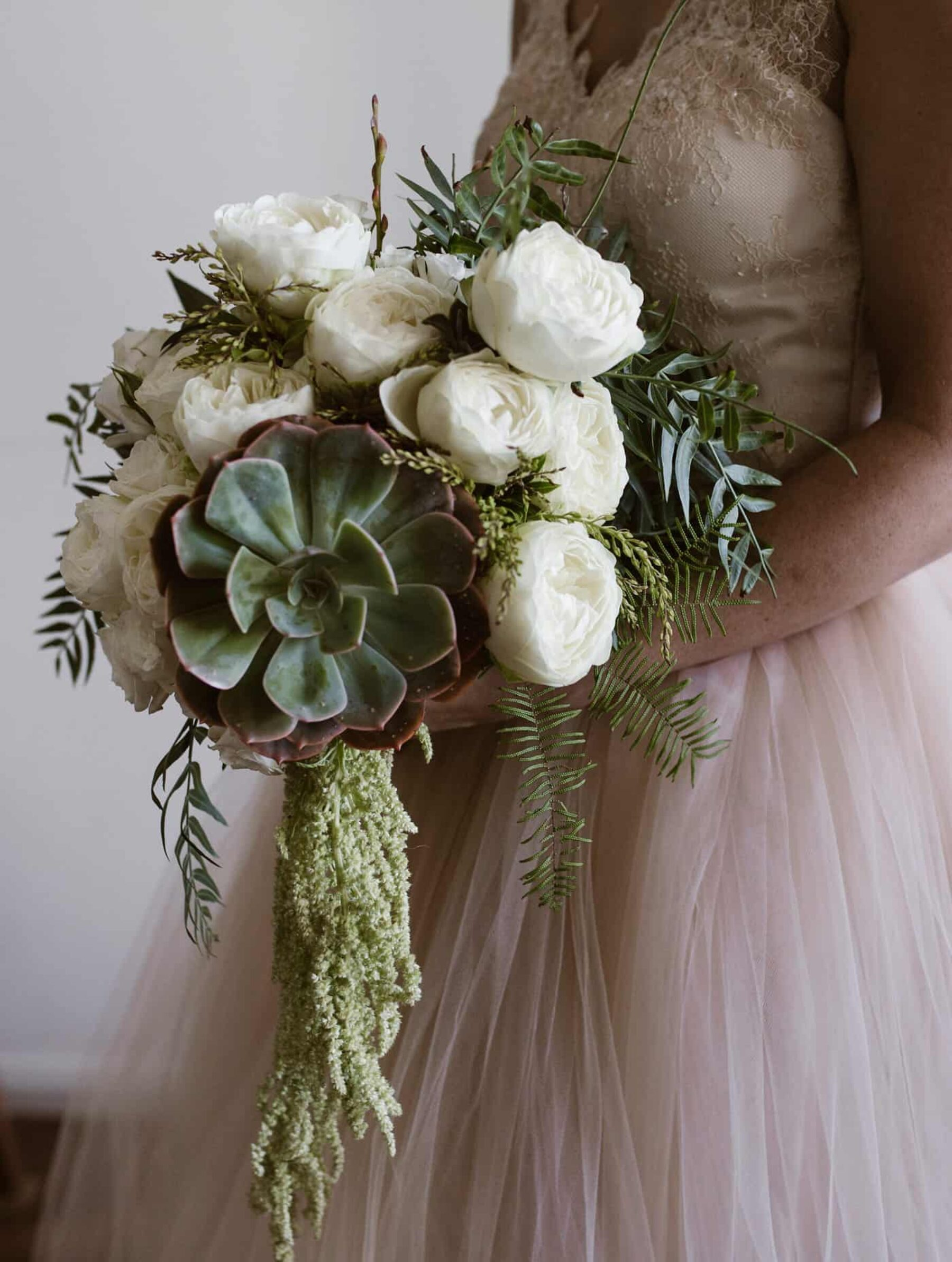 white and green bridal bouquet with succulents