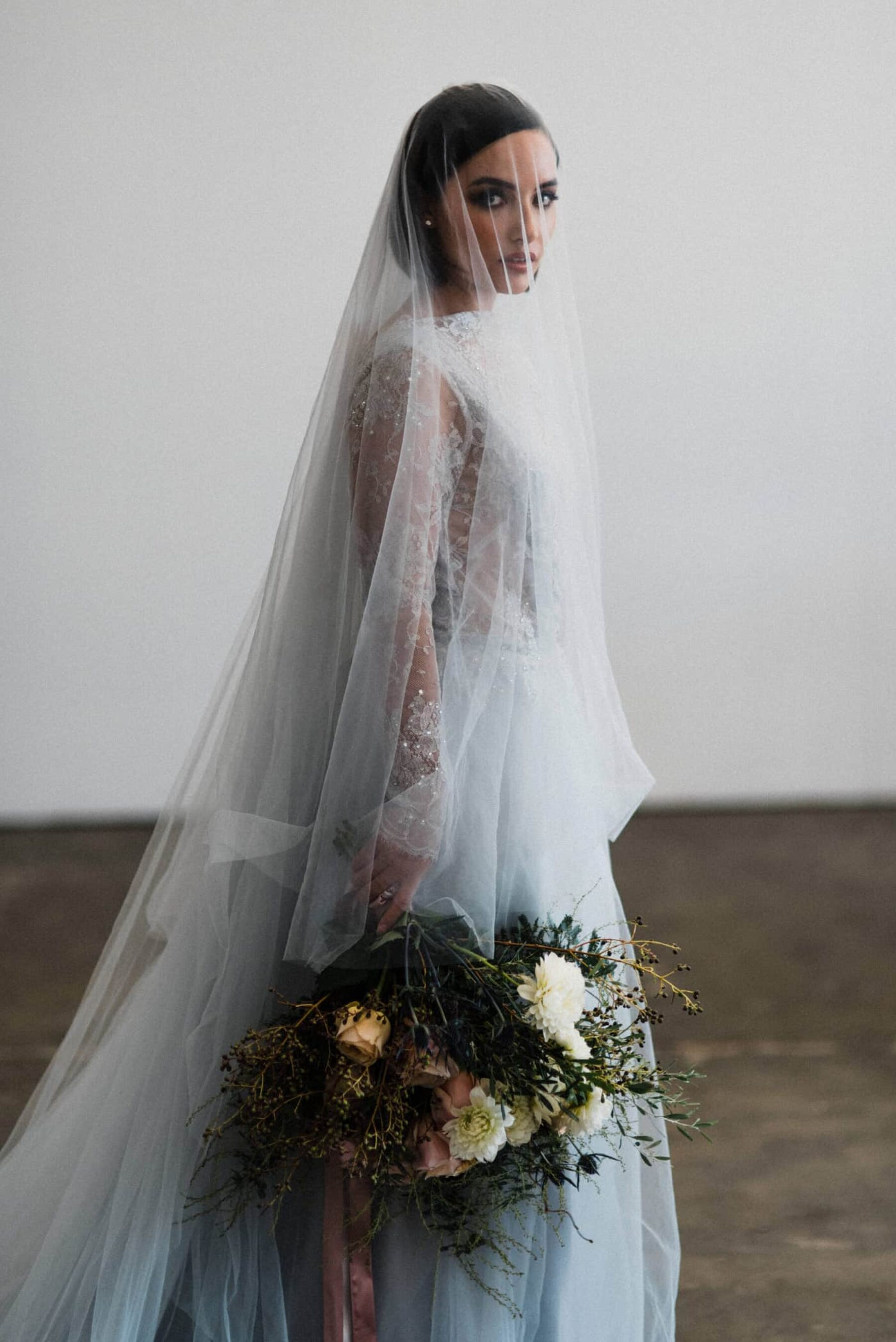 bride in dove blue lace wedding dress and veil