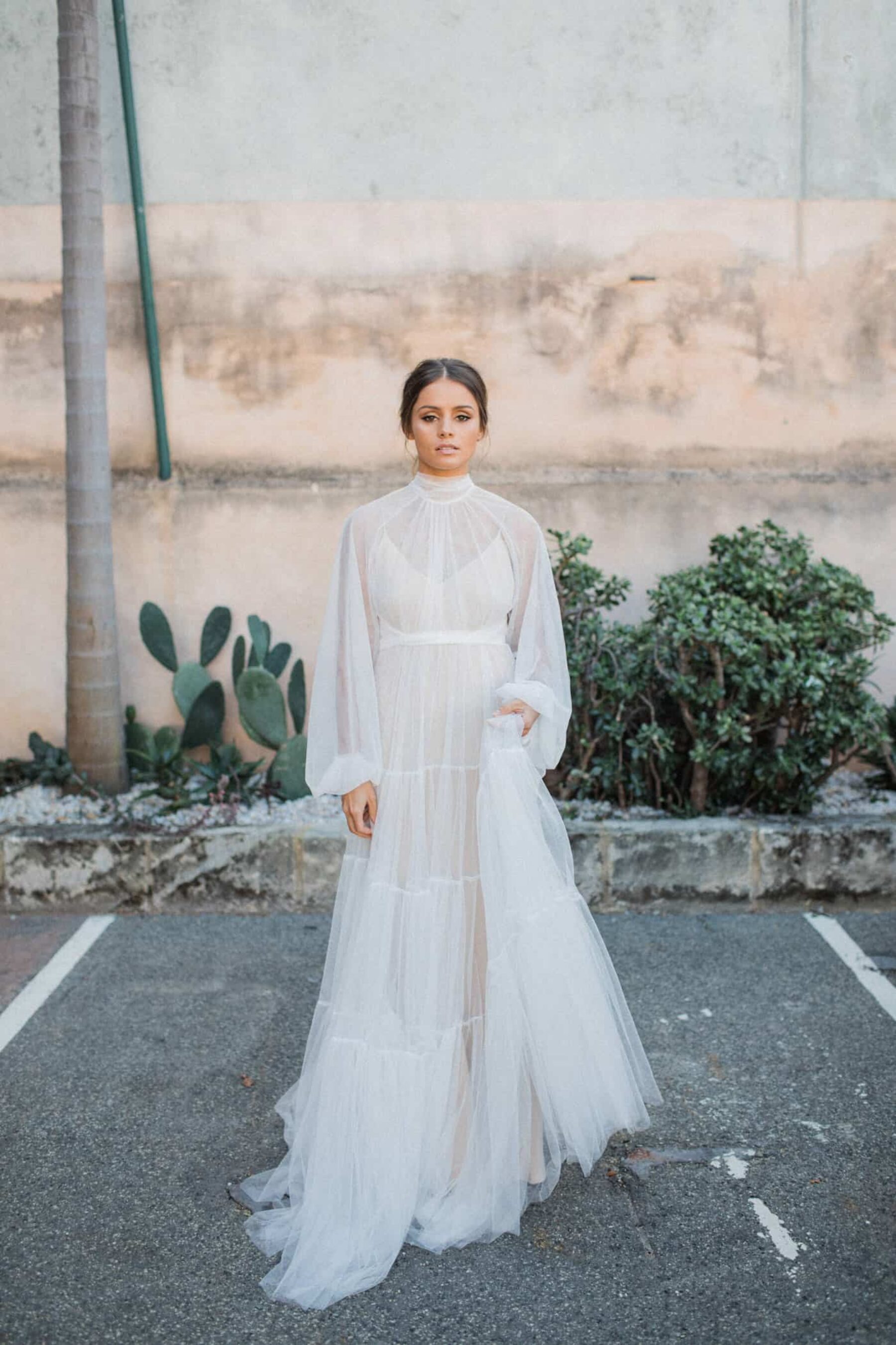 soft tulle gown with high neckline, billowing bishop sleeve and buttoned cuff