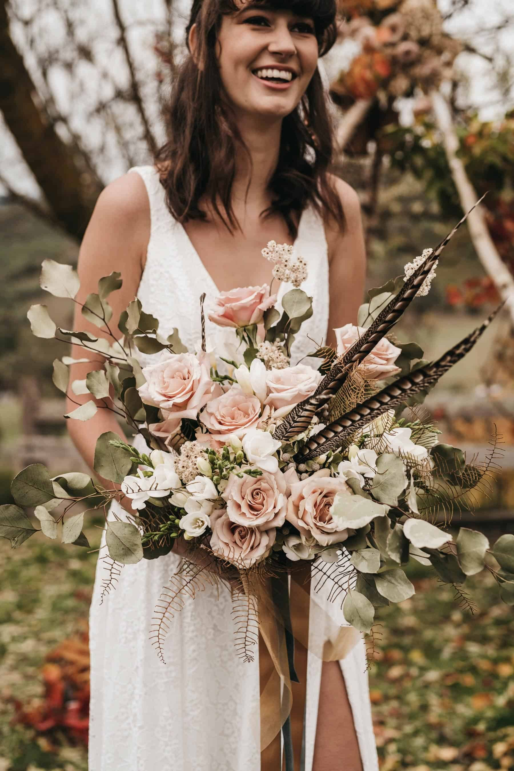 blush bridal bouquet with feathers