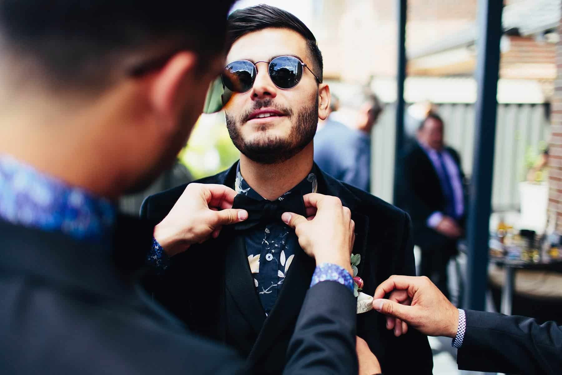 cool groom with floral shirt