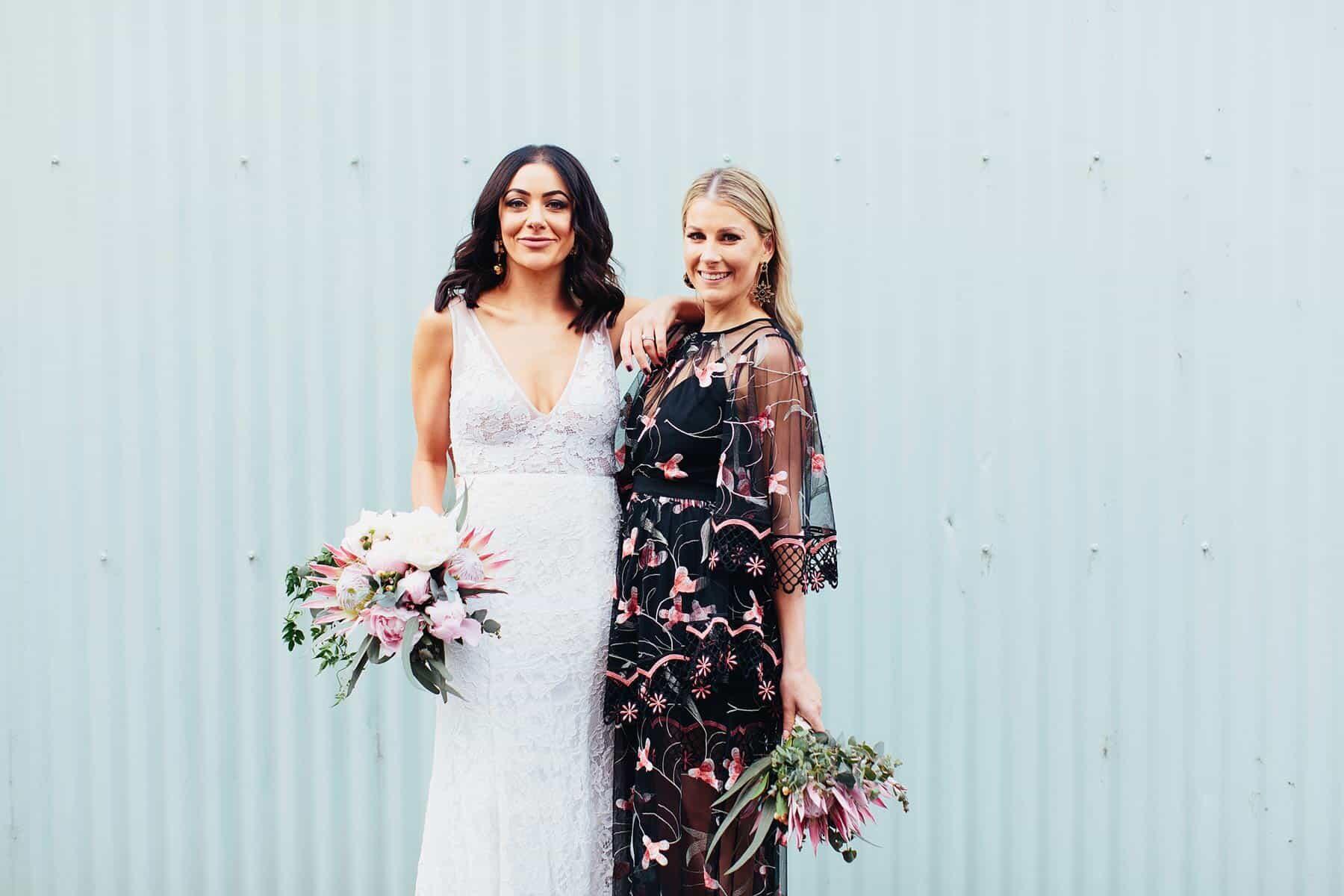 bridesmaid in black floral dress