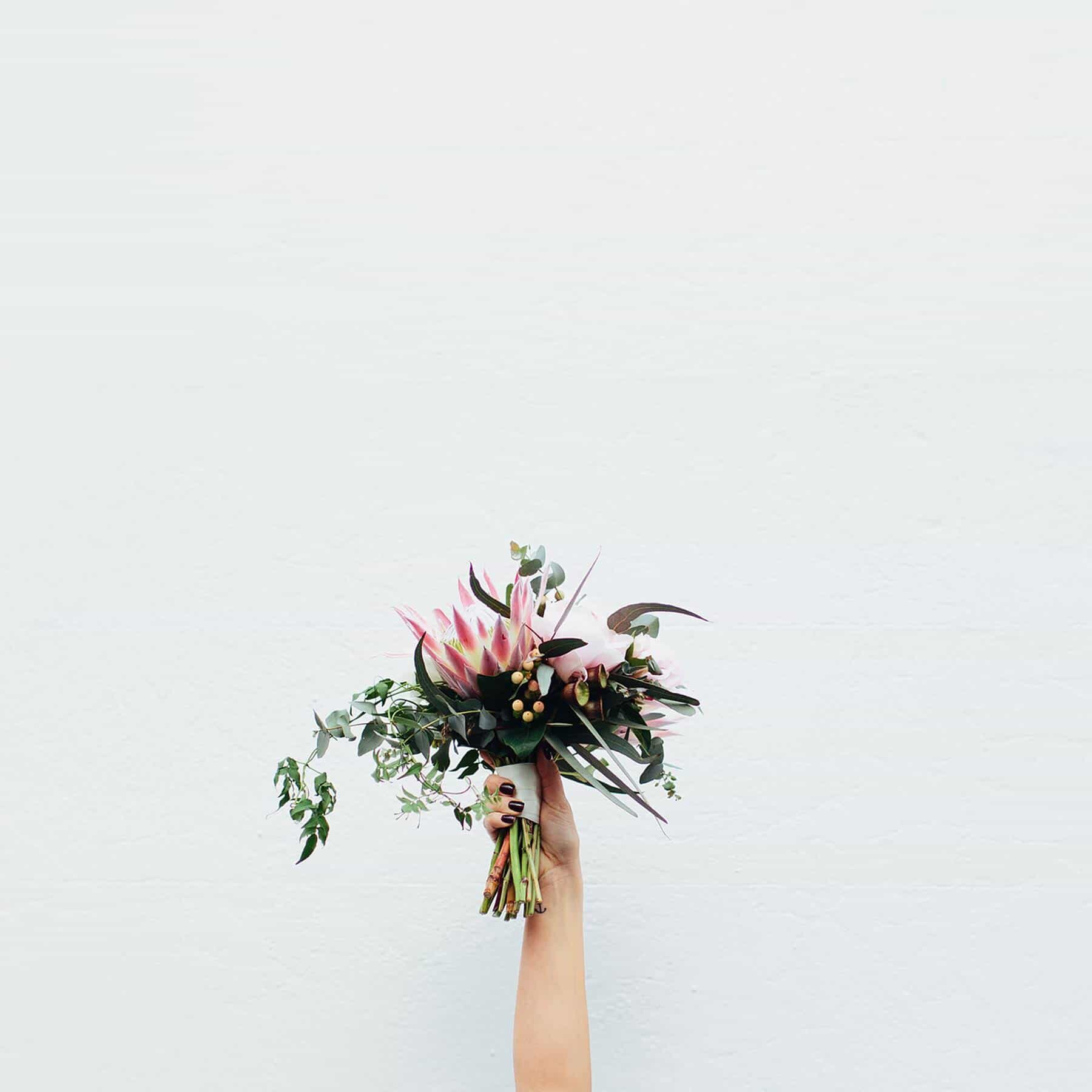 blush bridal bouquet with peonies and proteas
