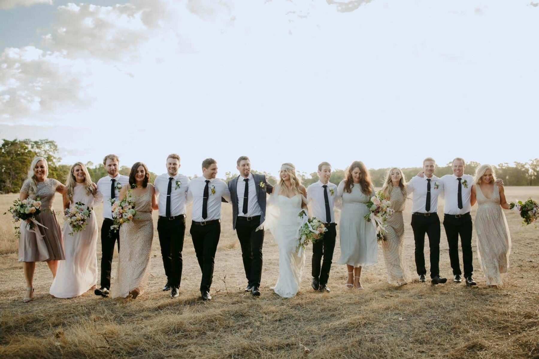 Gatsby inspired bridal party with mismatched neutral bridesmaid dresses