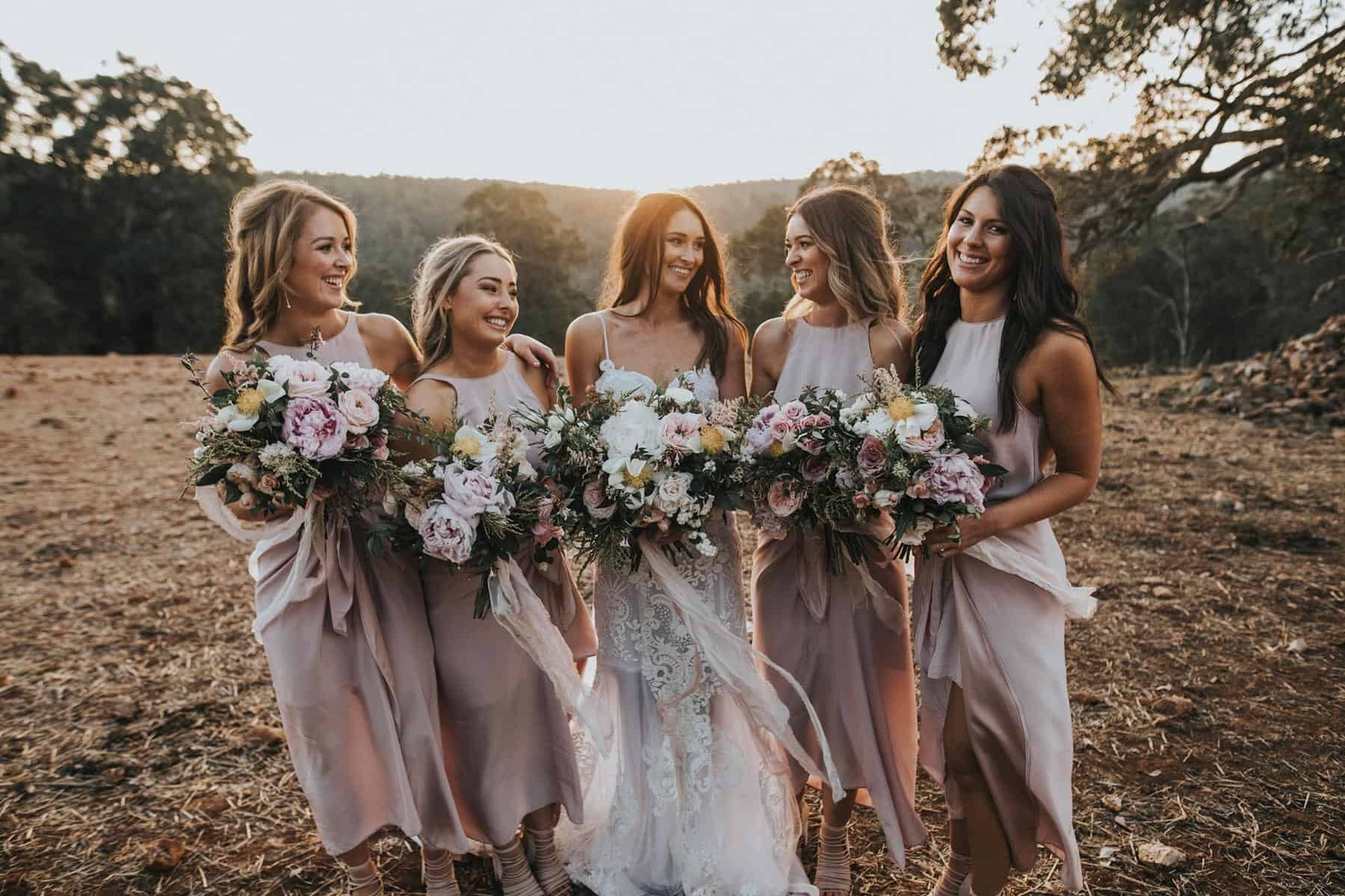 bridesmaids with blush peony bouquets