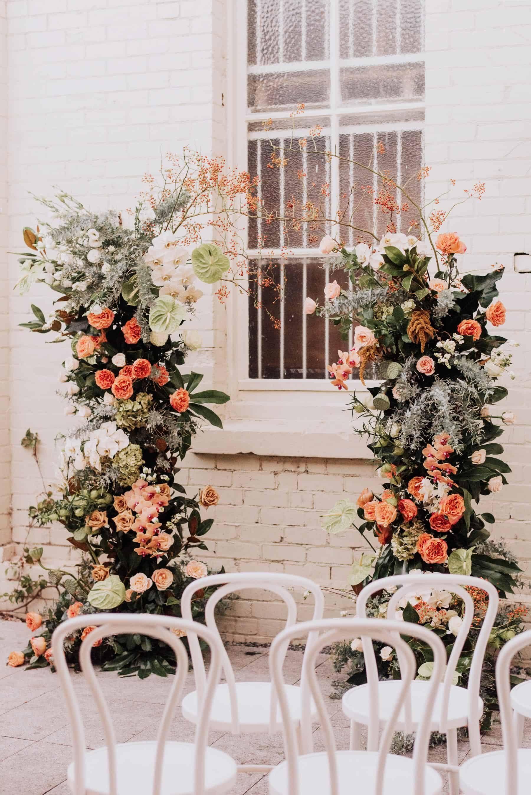 organic peach-toned floral wedding arch