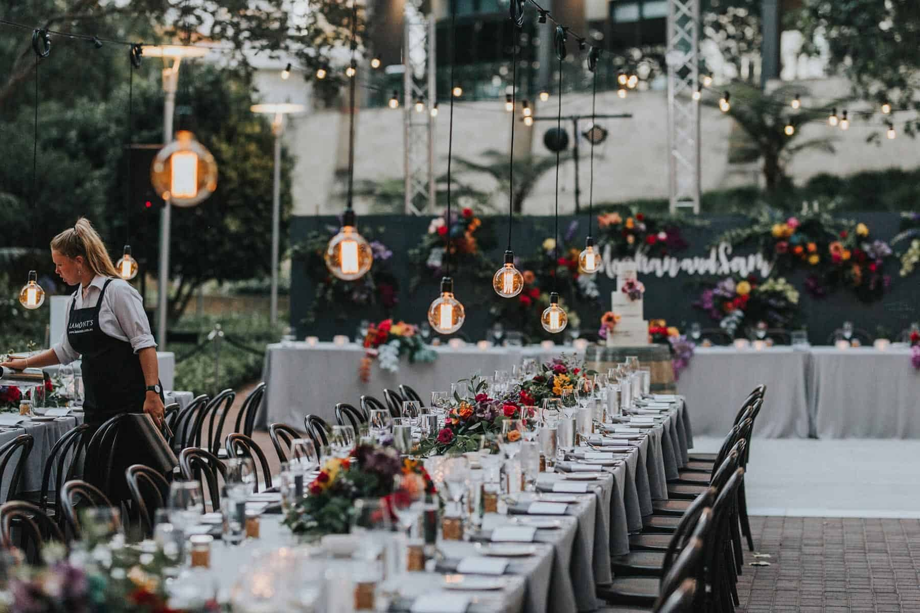floral tablescape with overhanging lights