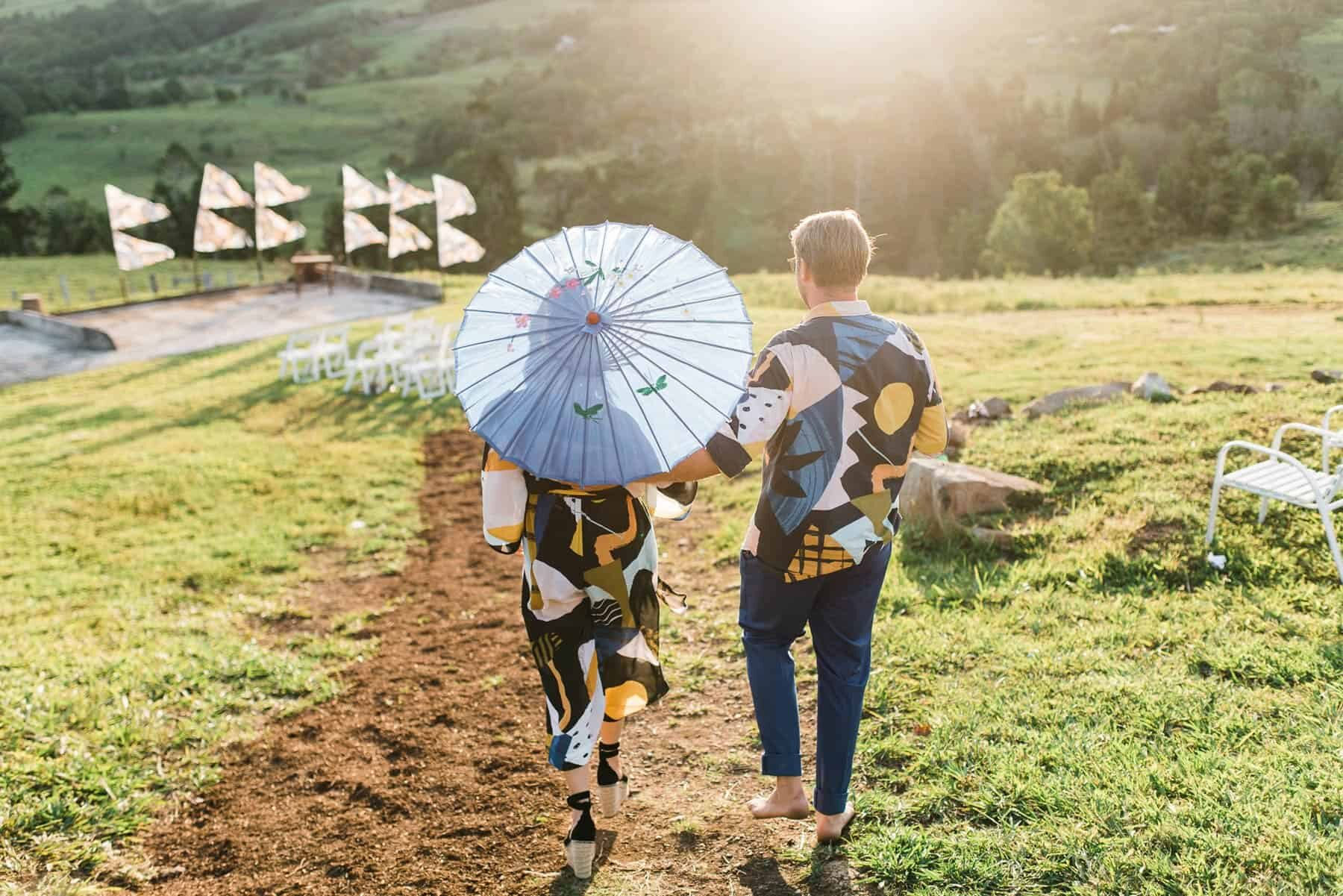 bride and groom in bold graphic prints