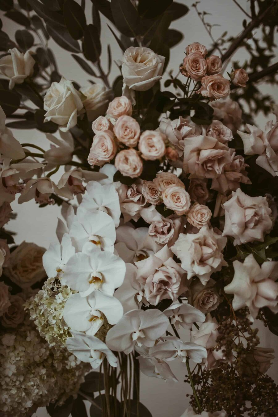 blush floral installation with roses and orchids