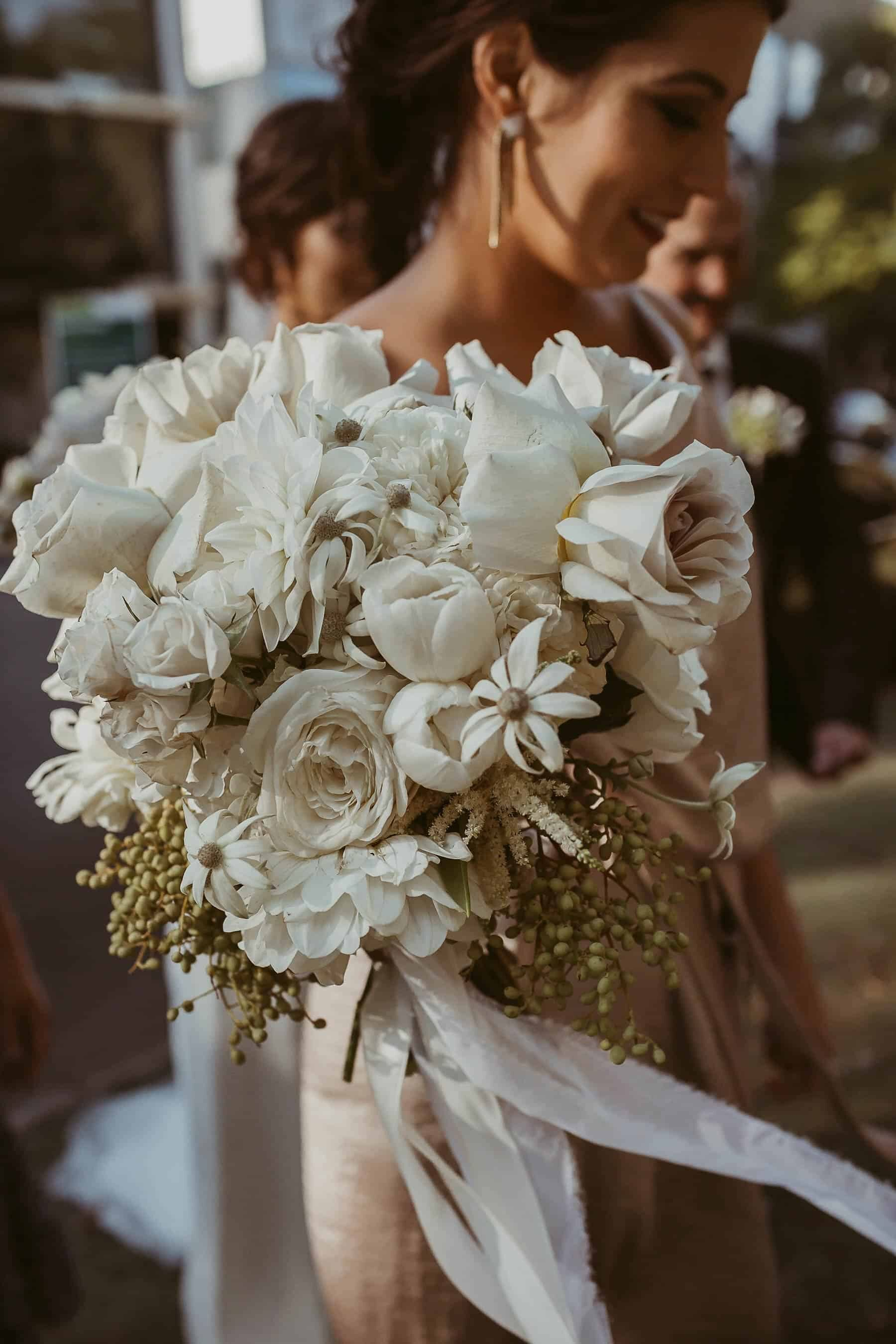 white and blush bridal bouquet with nude roses and flannel flower
