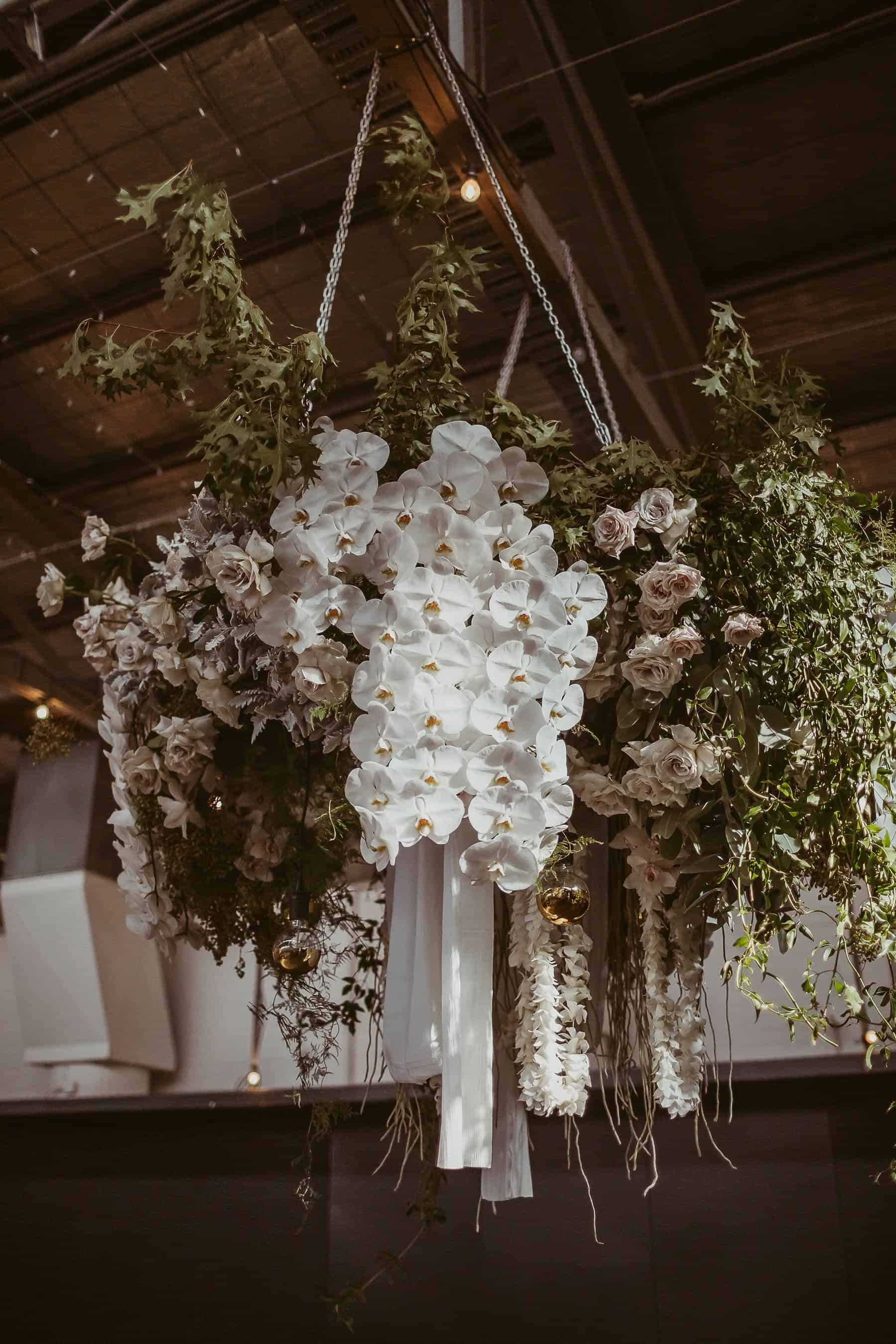 modern blush floral installation with roses and orchids