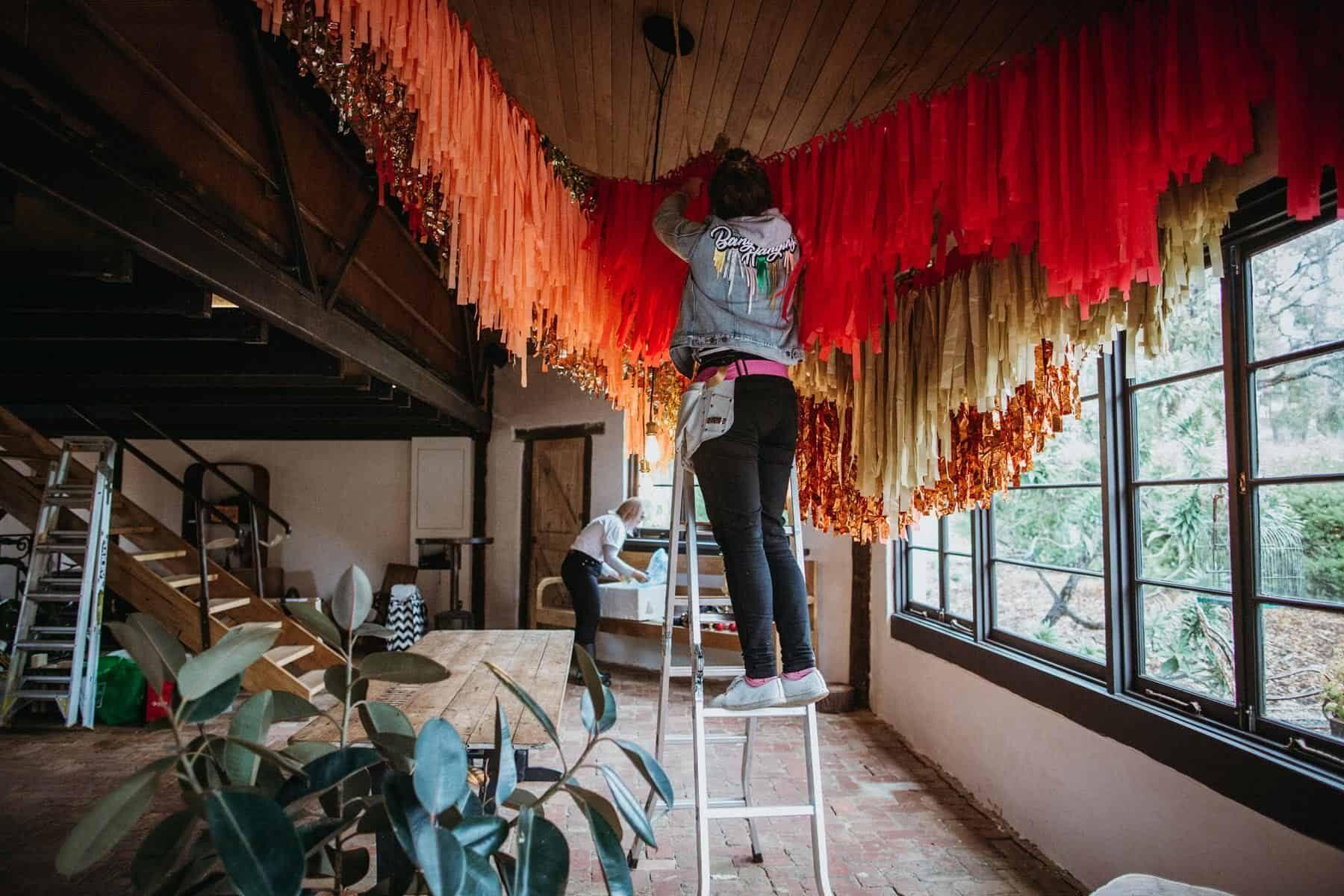 epic pink and gold paper fringe installation by Bangin Hangins