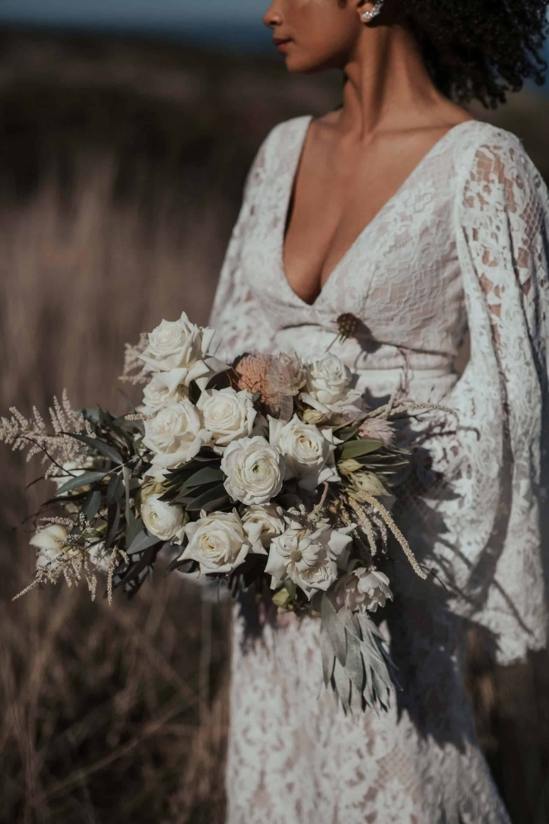 white bridal bouquet with roses and flannel flower