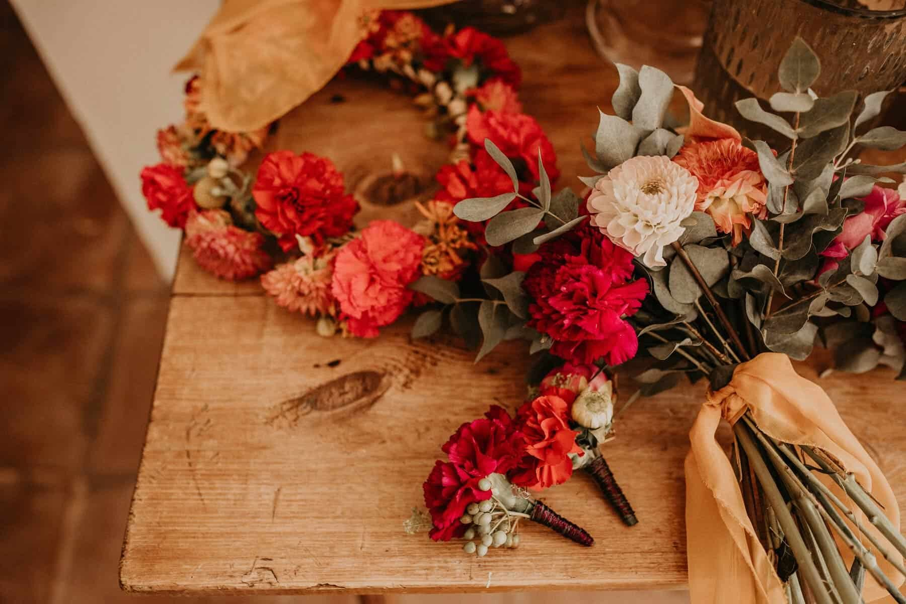 red flower crown for a boho bride