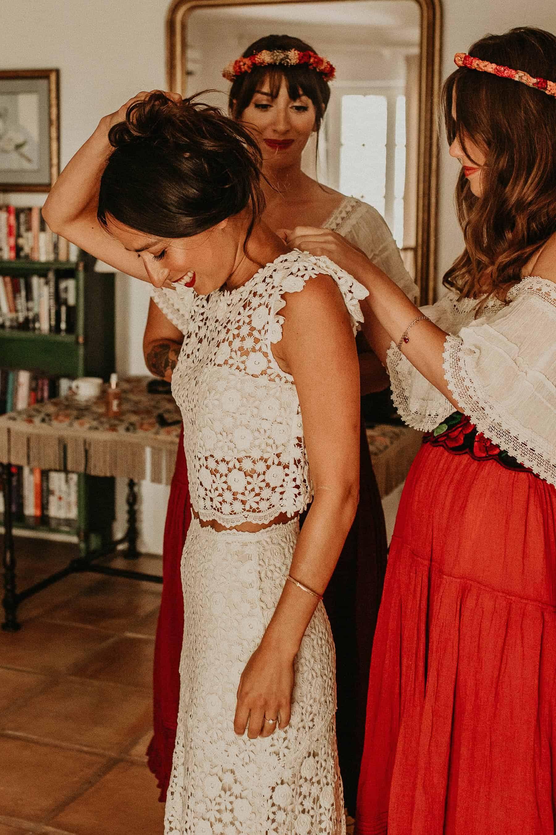 boho bride in two piece crochet wedding dress and Frida Kahlo flower crown