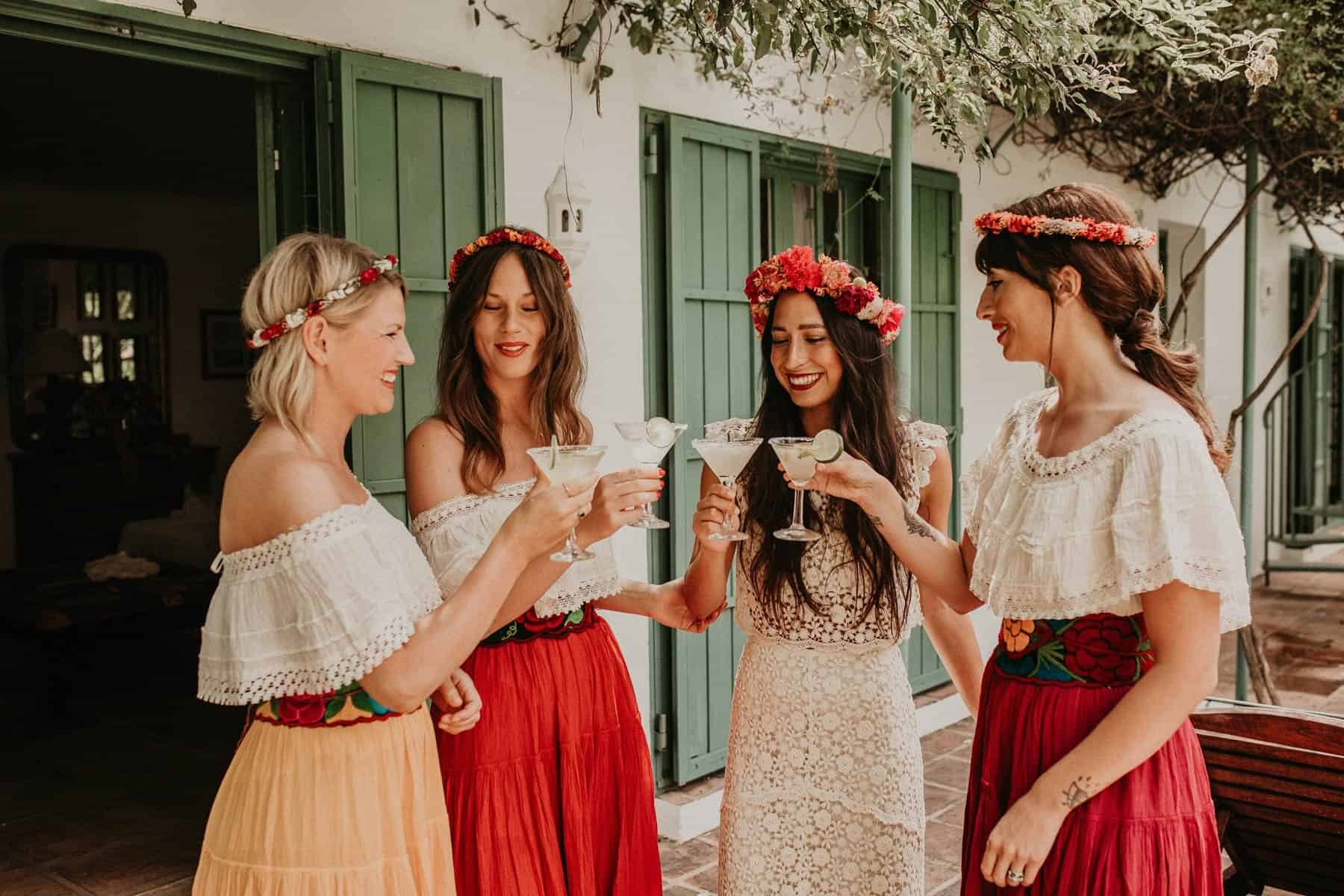 boho bride and mismatched bridesmaids with flower crowns