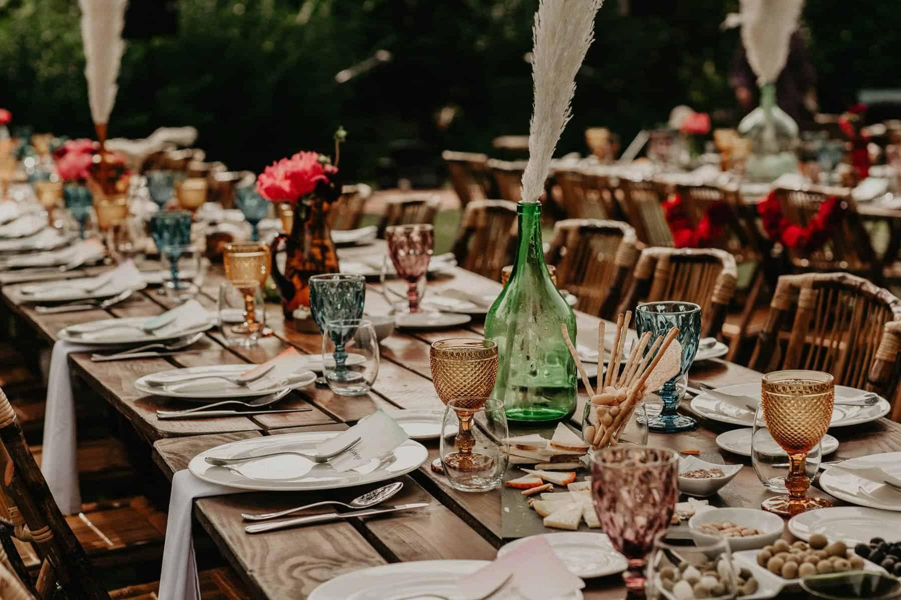 vibrant outdoor tablescape with colour glassware