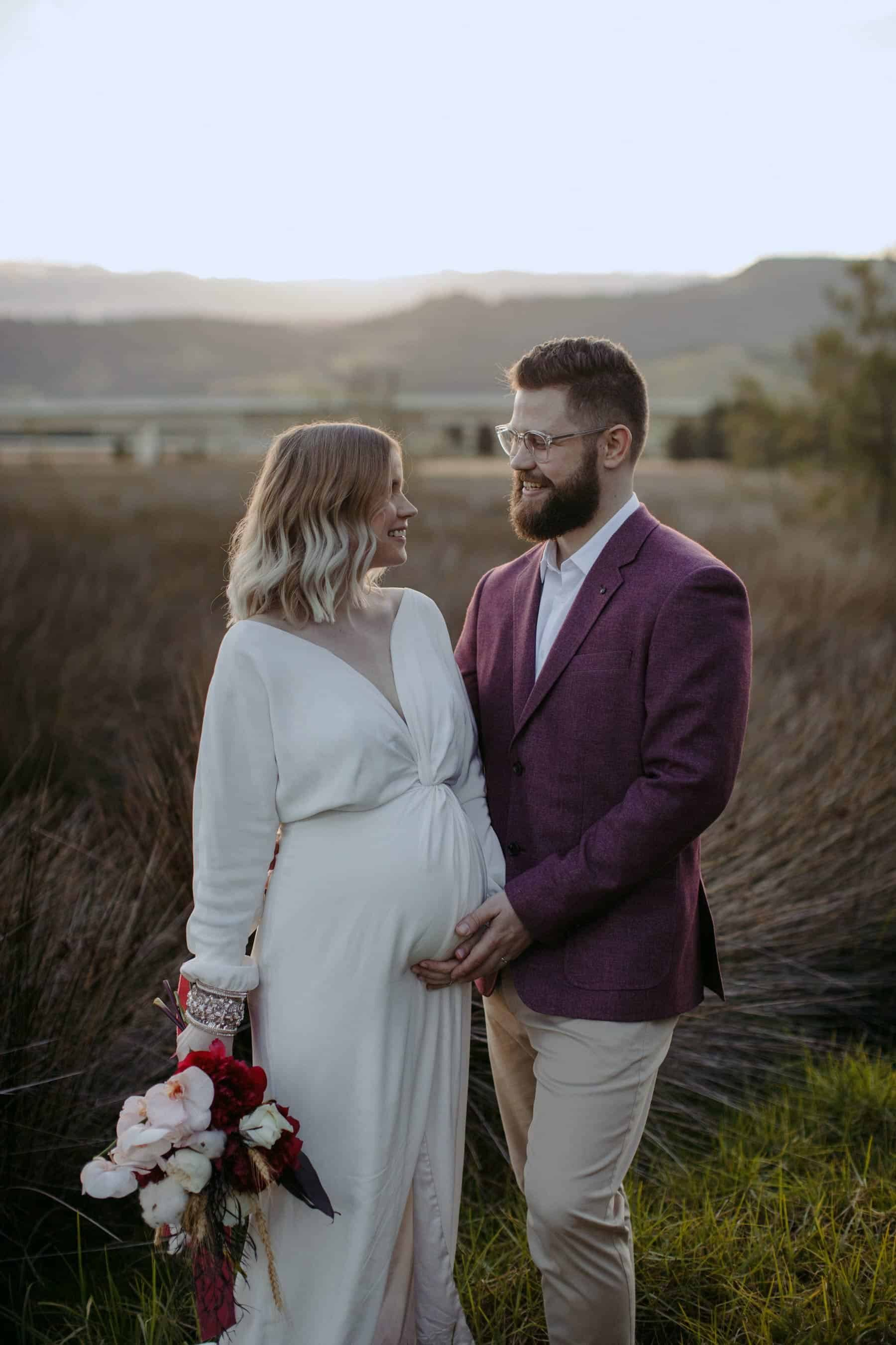 pregnant bride in modern long sleeve wedding dress by Bo & Luca