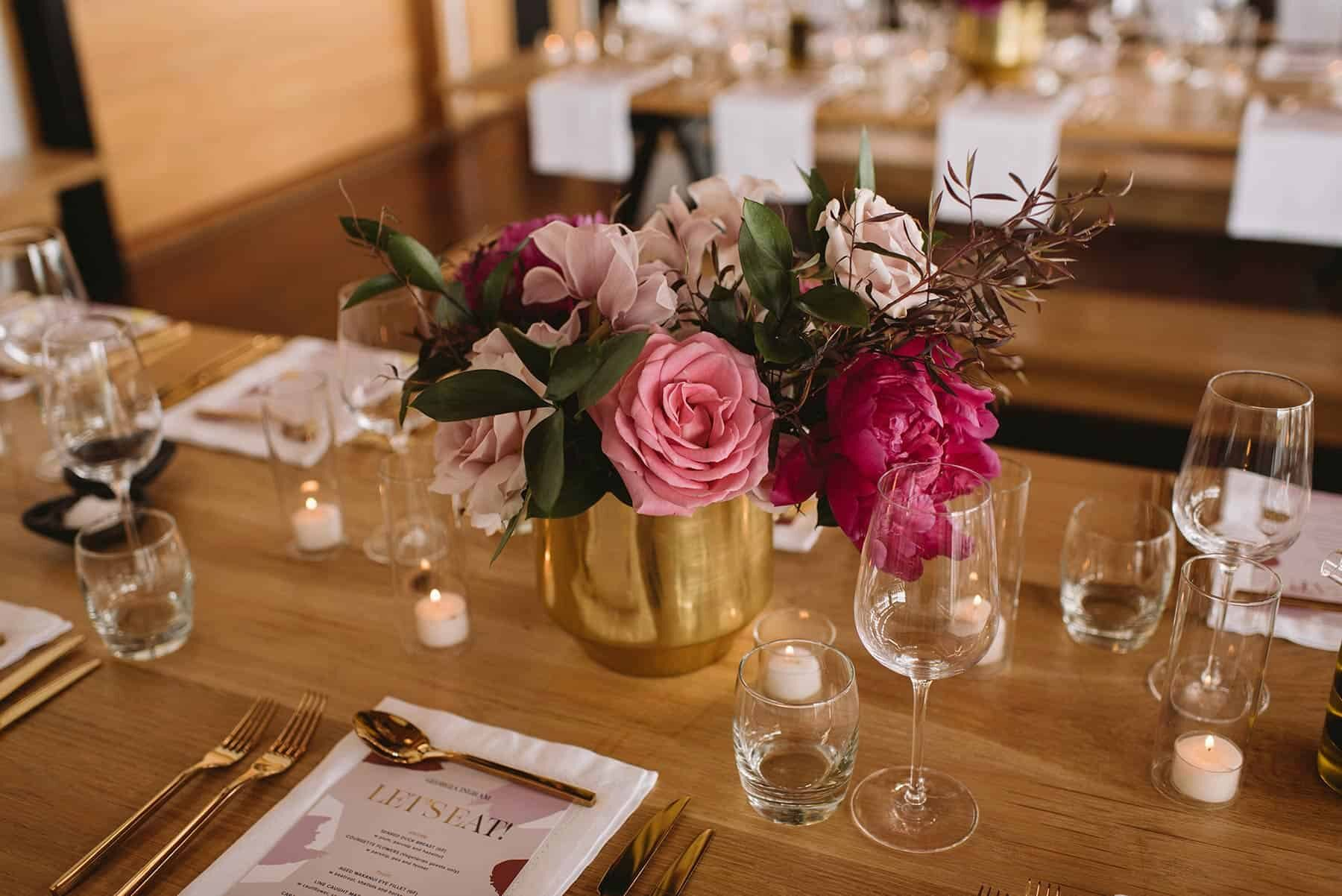 pink table flowers in gold vase