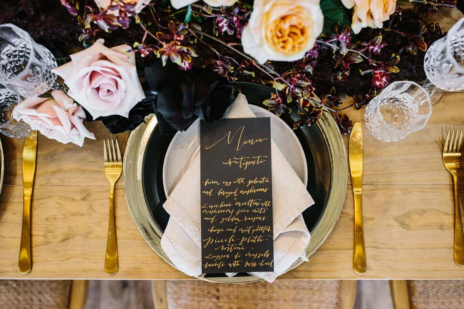 modern tablescape with blush and burgundy flowers