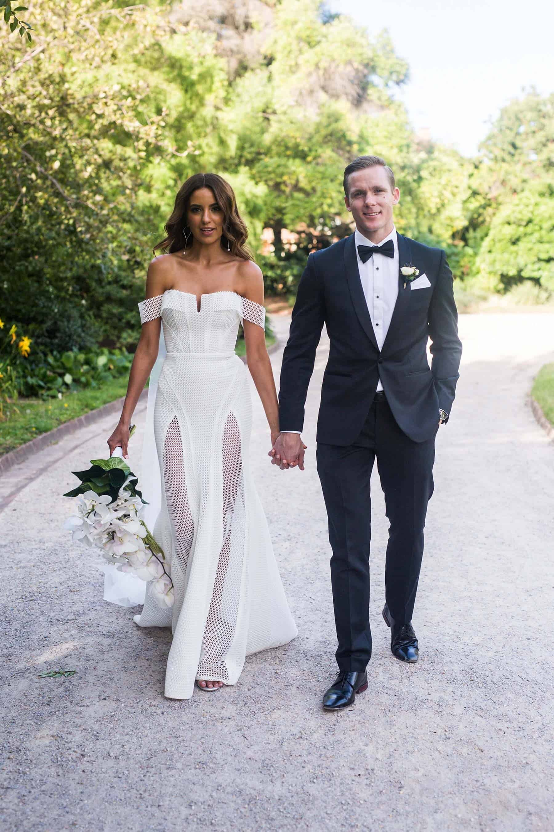 modern bride in sheer panelled wedding dress by Georgia young Couture