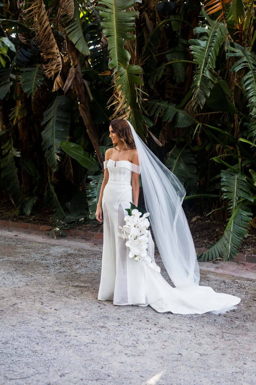 modern bride in off-shoulder wedding dress by Georgia young Couture