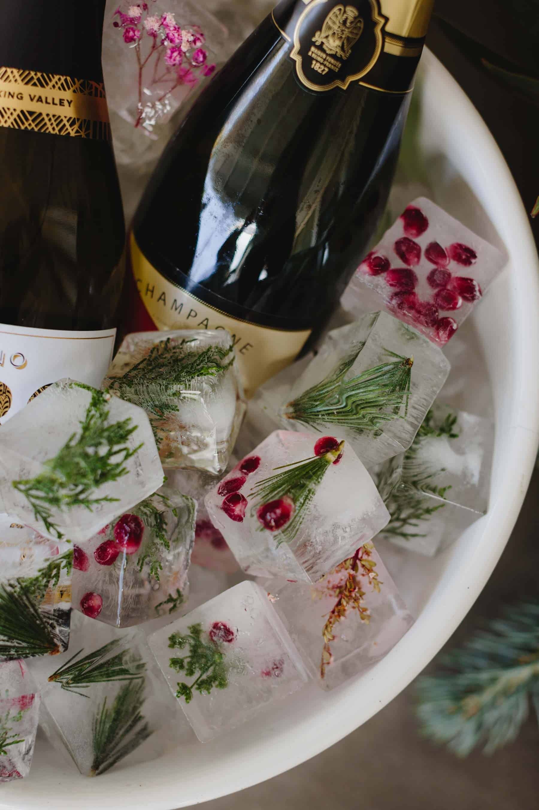 Christmas ice blocks with pine, berries and edible flowers