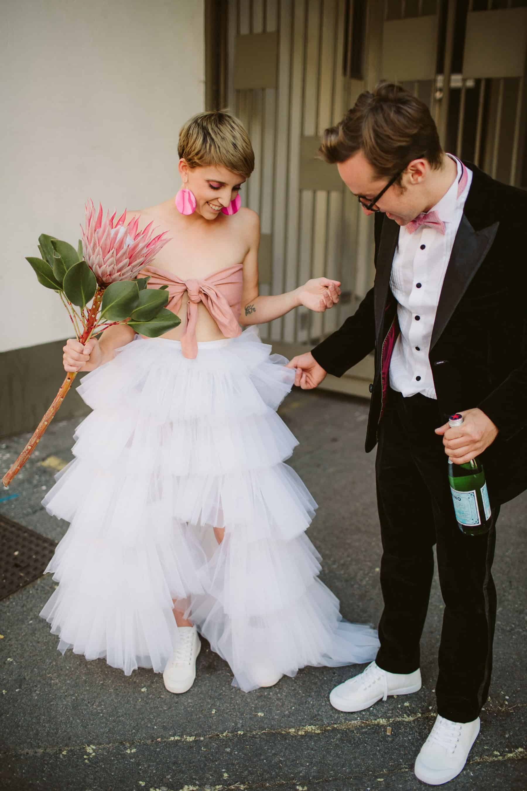 quirky bride in tiered tulle two-piece wedding dress with pink bandeau top