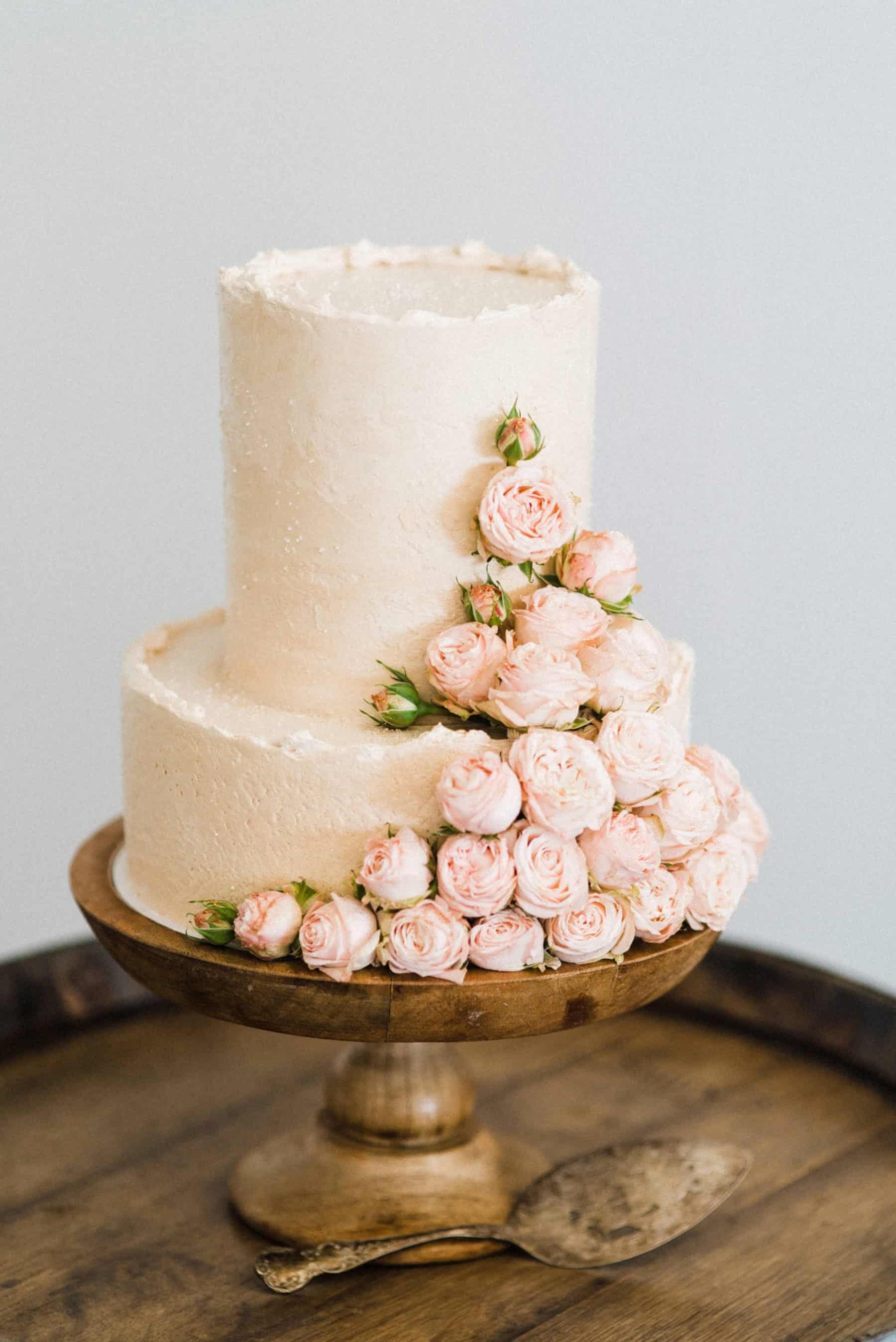 Pastel pink wedding cake with roses