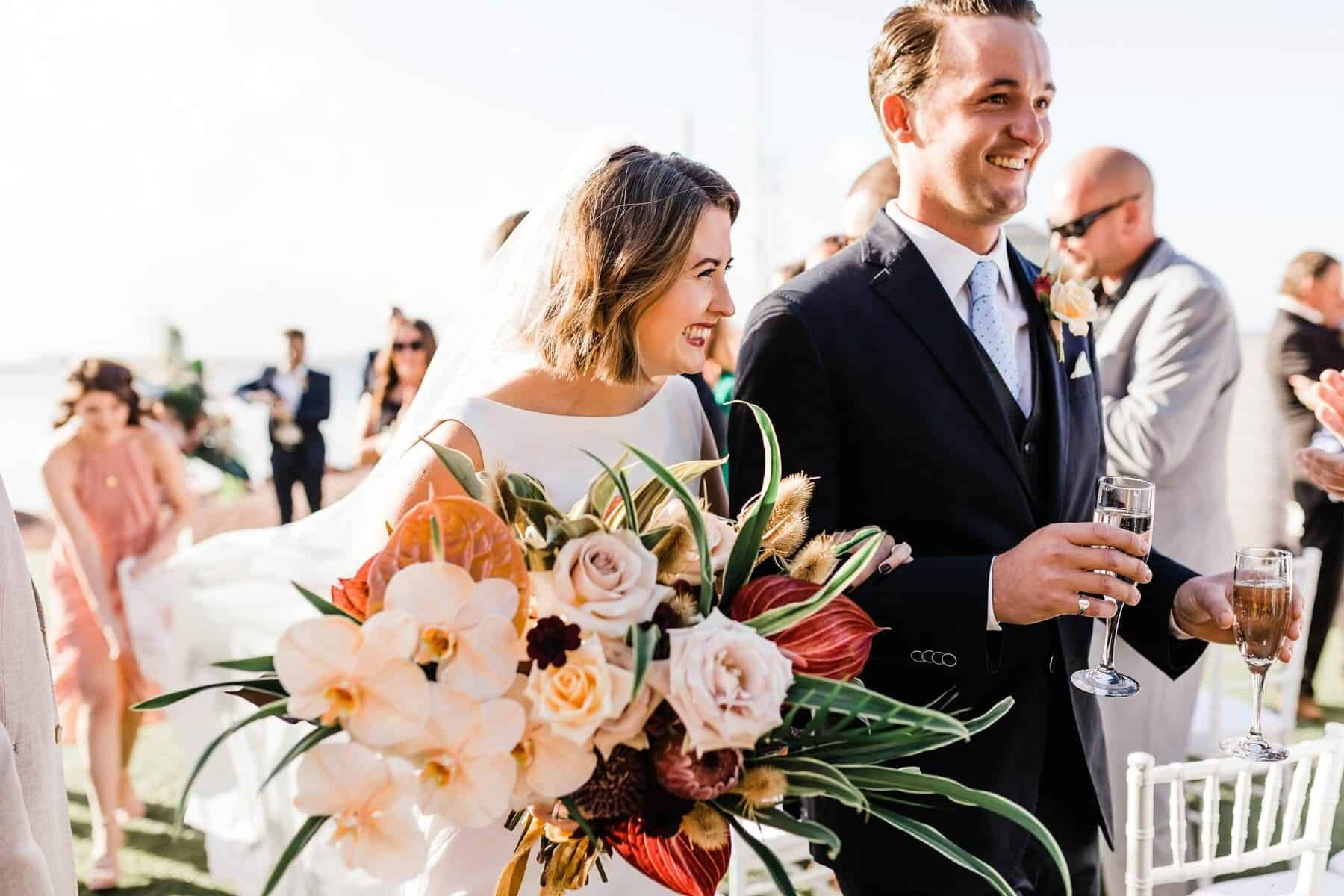 Best of 2018: bouquets. tropical bridal bouquet with peach orchids