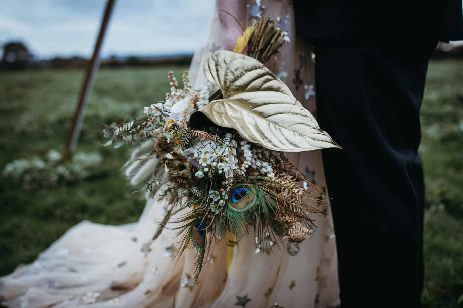 unique bridal bouquet with painted gold leaf and feathers
