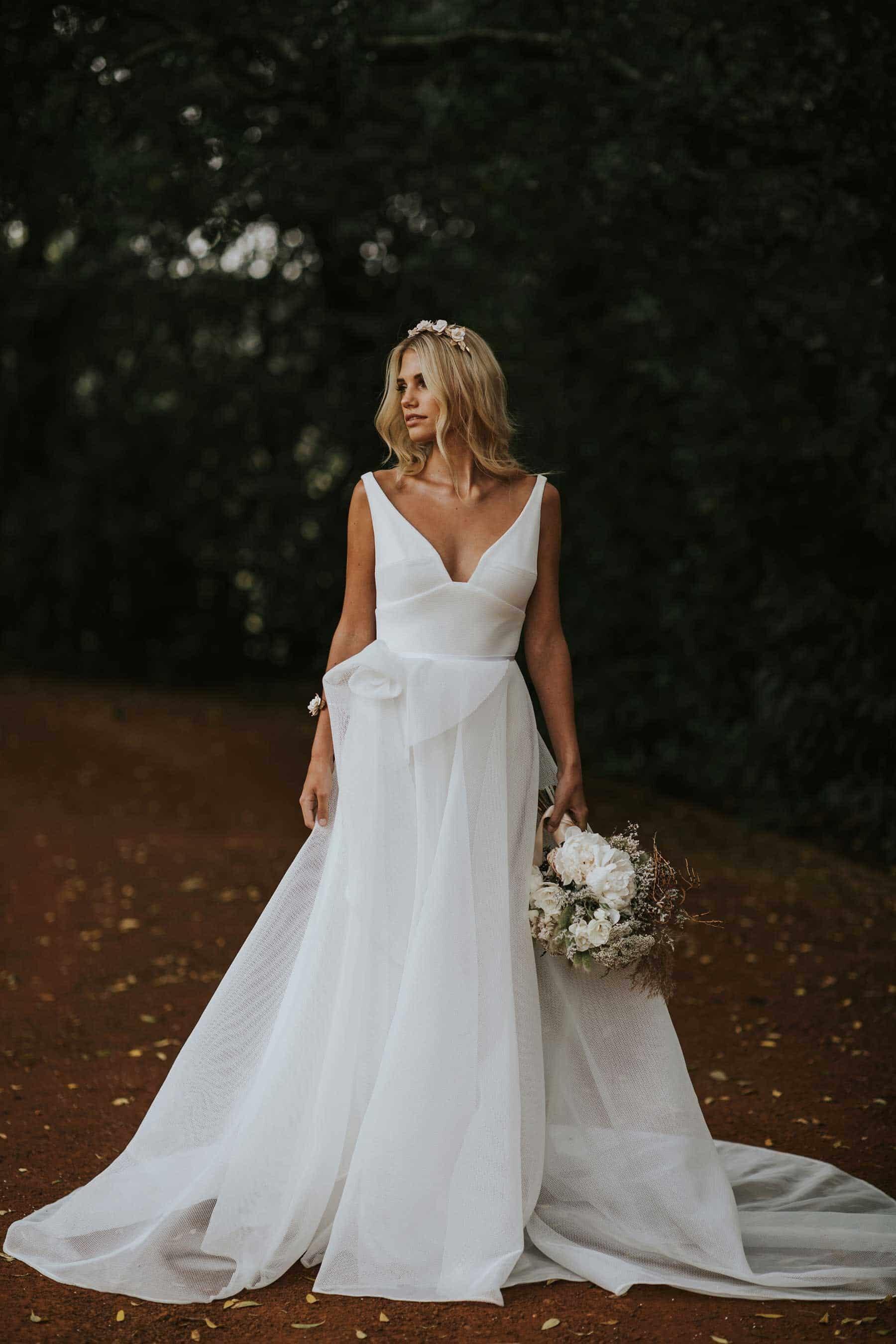 v-neck wedding dress with full sculptural skirt