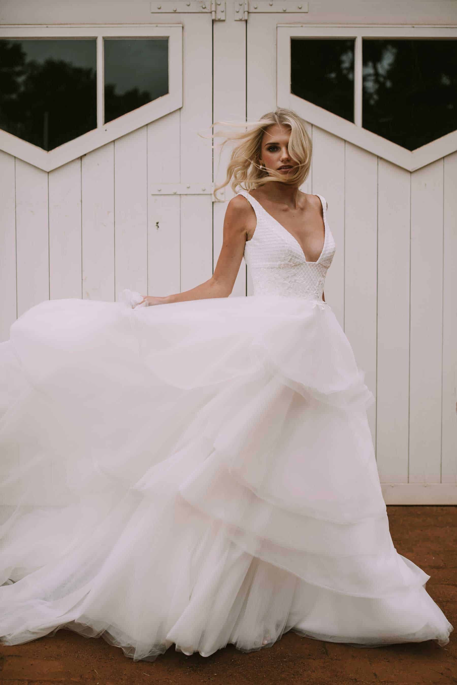 v-neck wedding dress with tiered tulle skirt