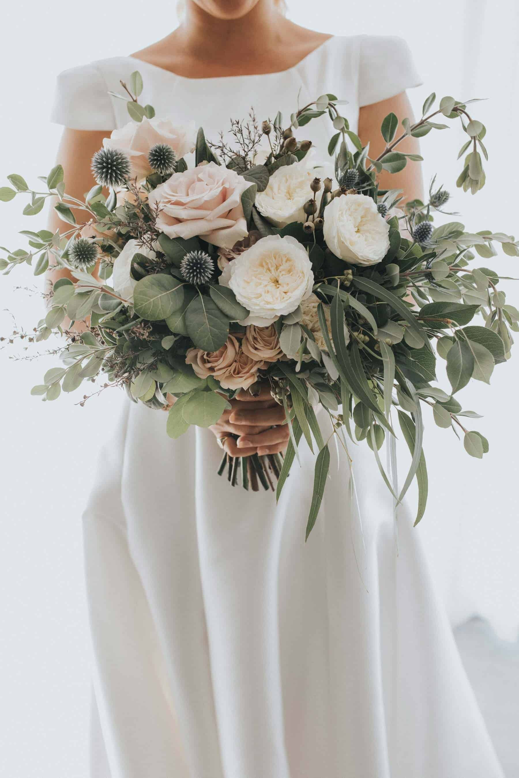 blush and sage bridal bouquet with quicksand roses and thistle