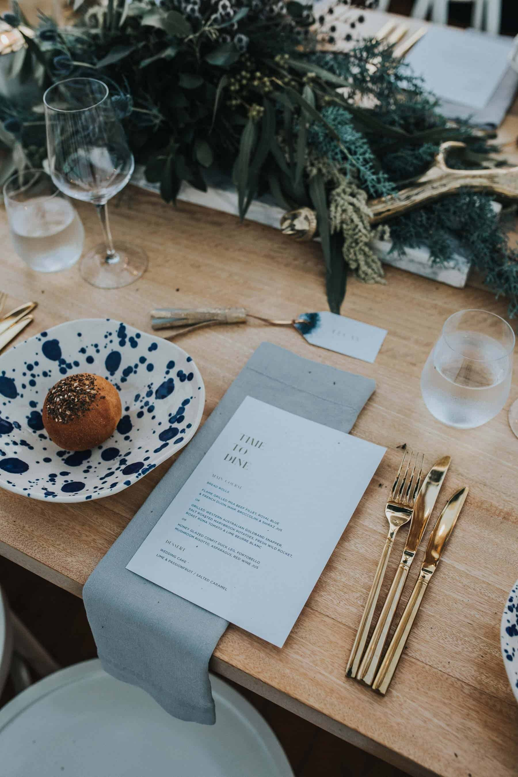 modern table setting with gold cutlery