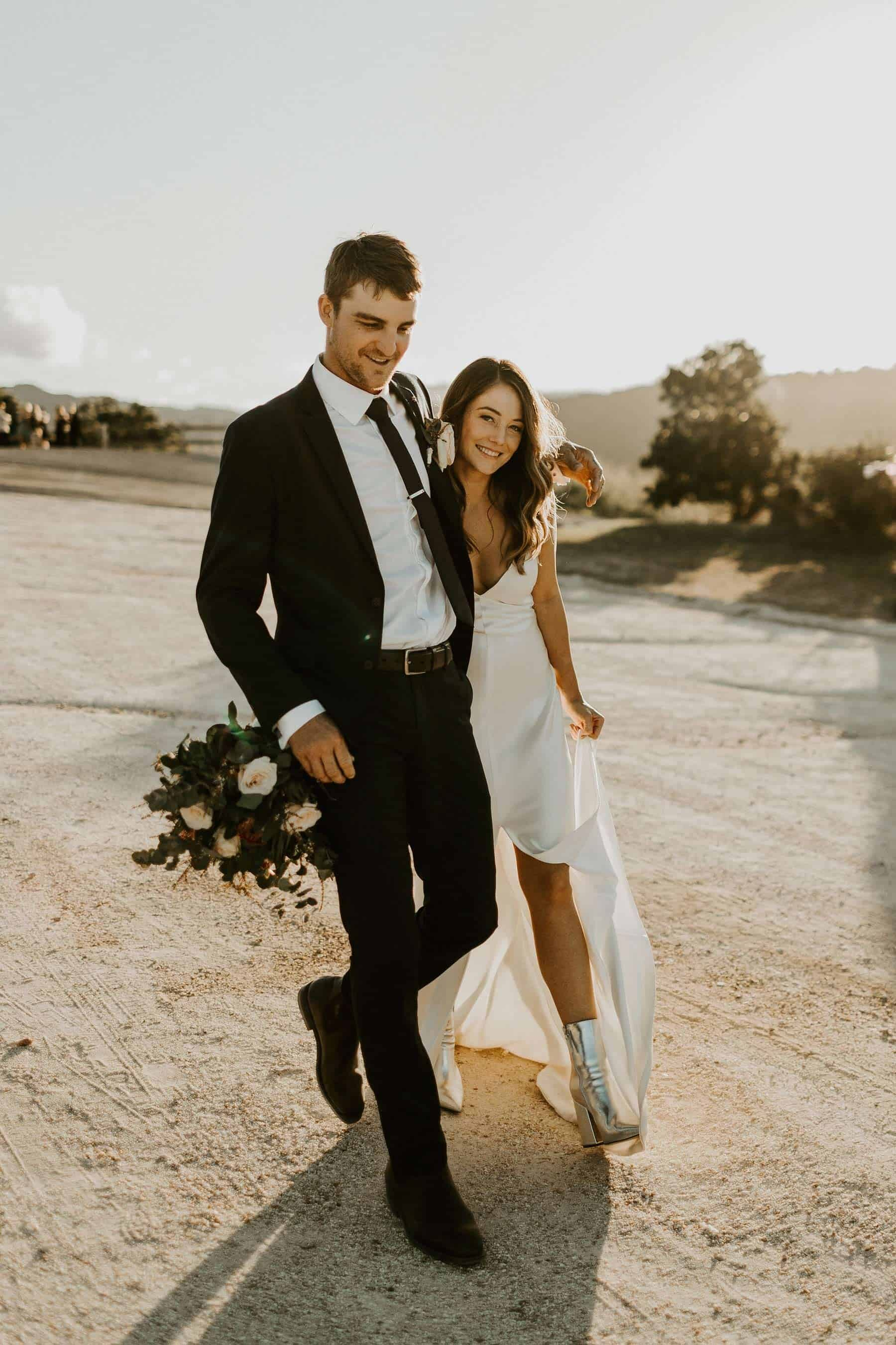 cool bride in minimal dress and silver boots