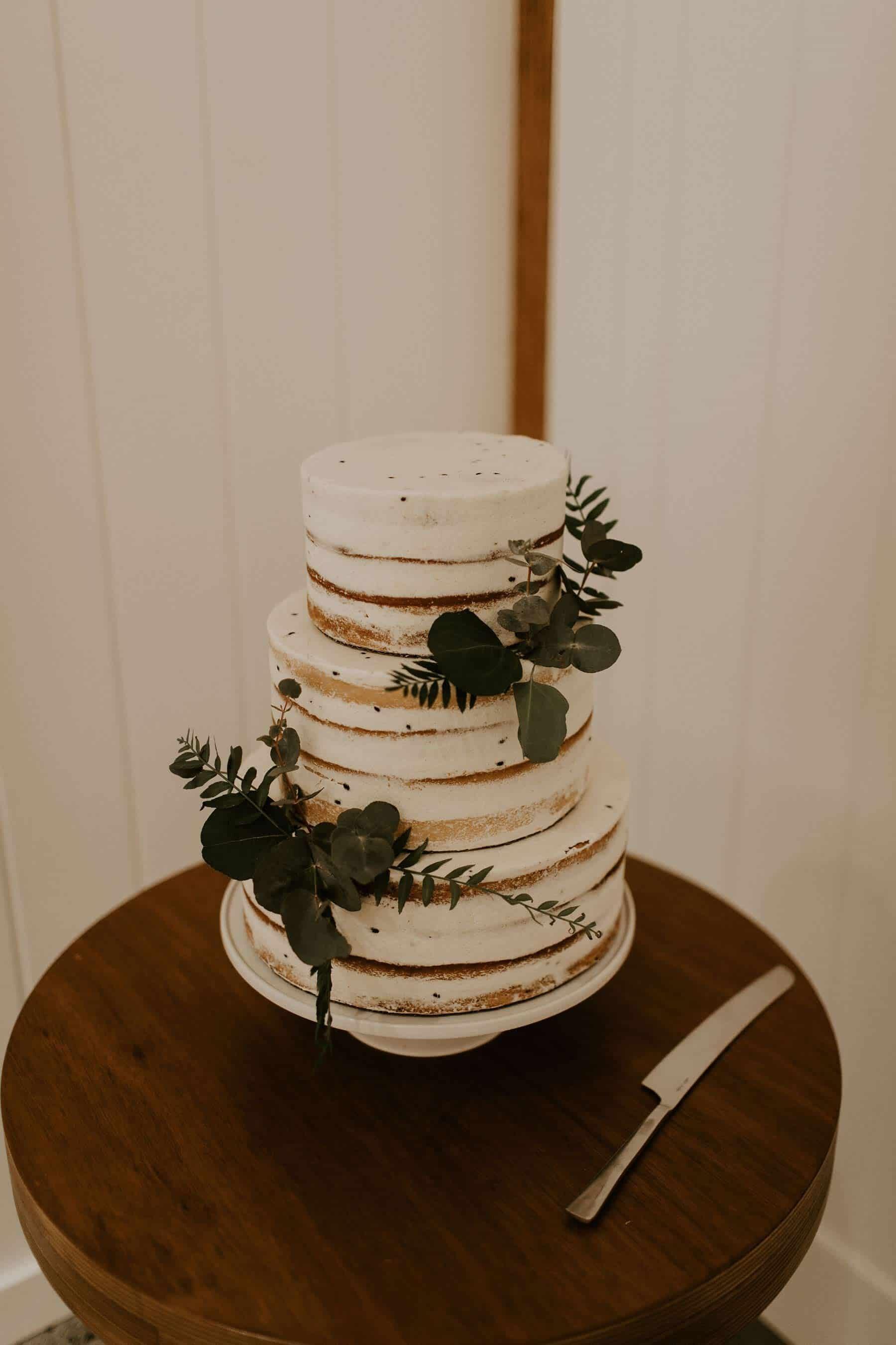 three tier naked white wedding cake