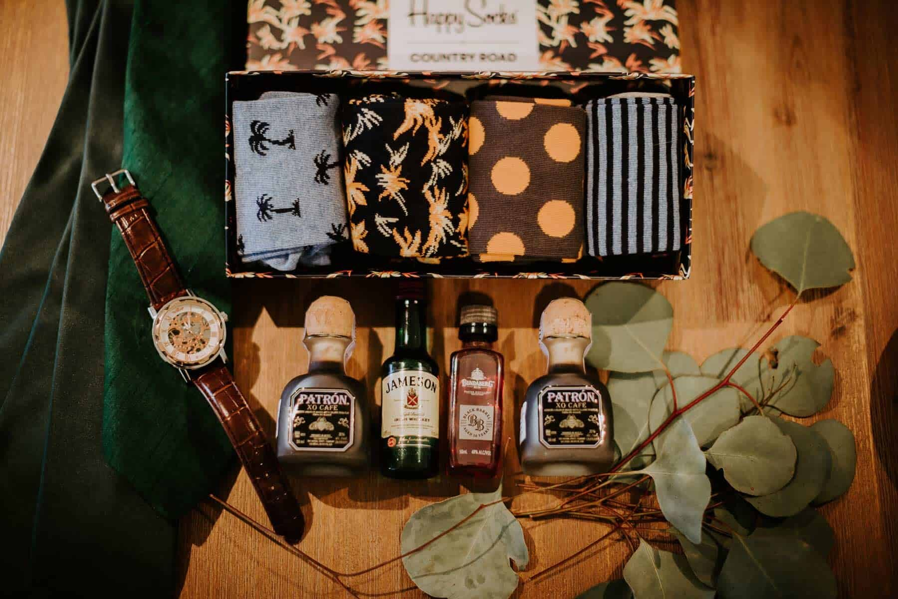 groom flatlay with whiskey and socks