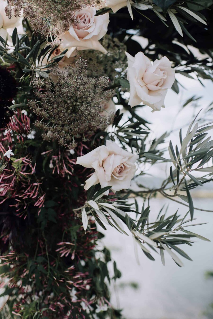 floral wedding arbour in blush and plum palette