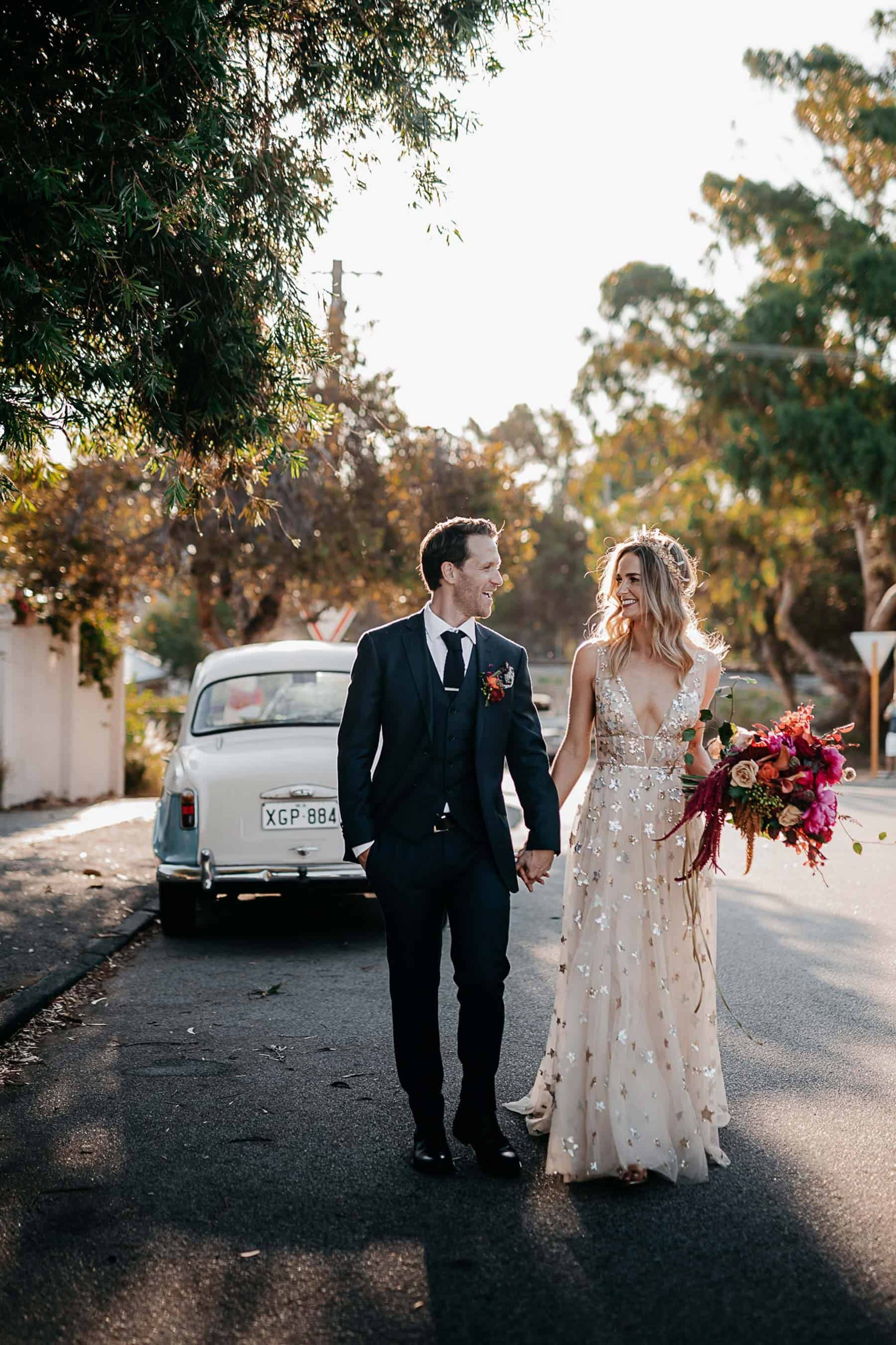 bride wears gold willowby by watters with gold amaroq crown and vibrant pink bouquet for fremantle wedding
