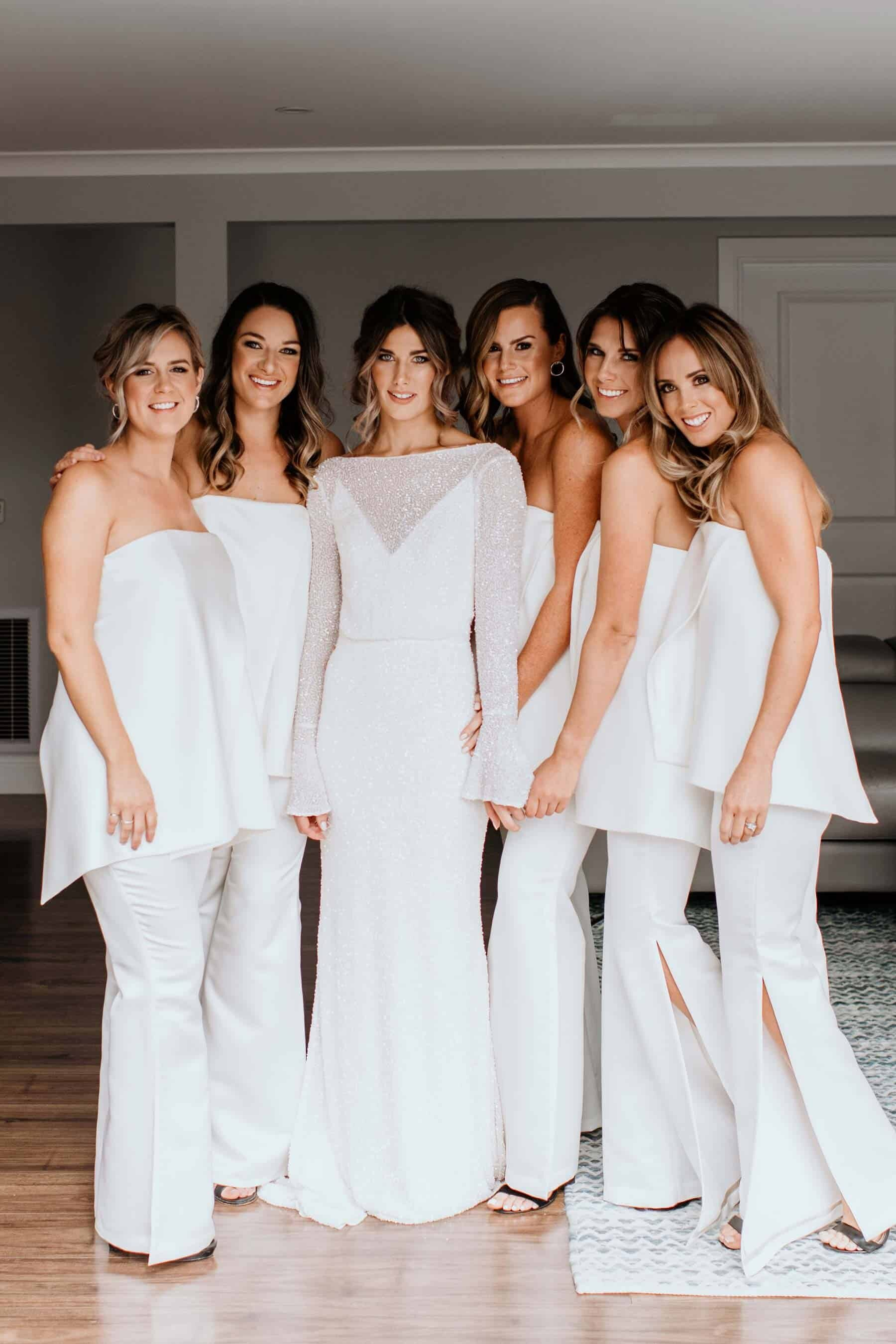 modern bride and bridesmaids in white jumpsuits